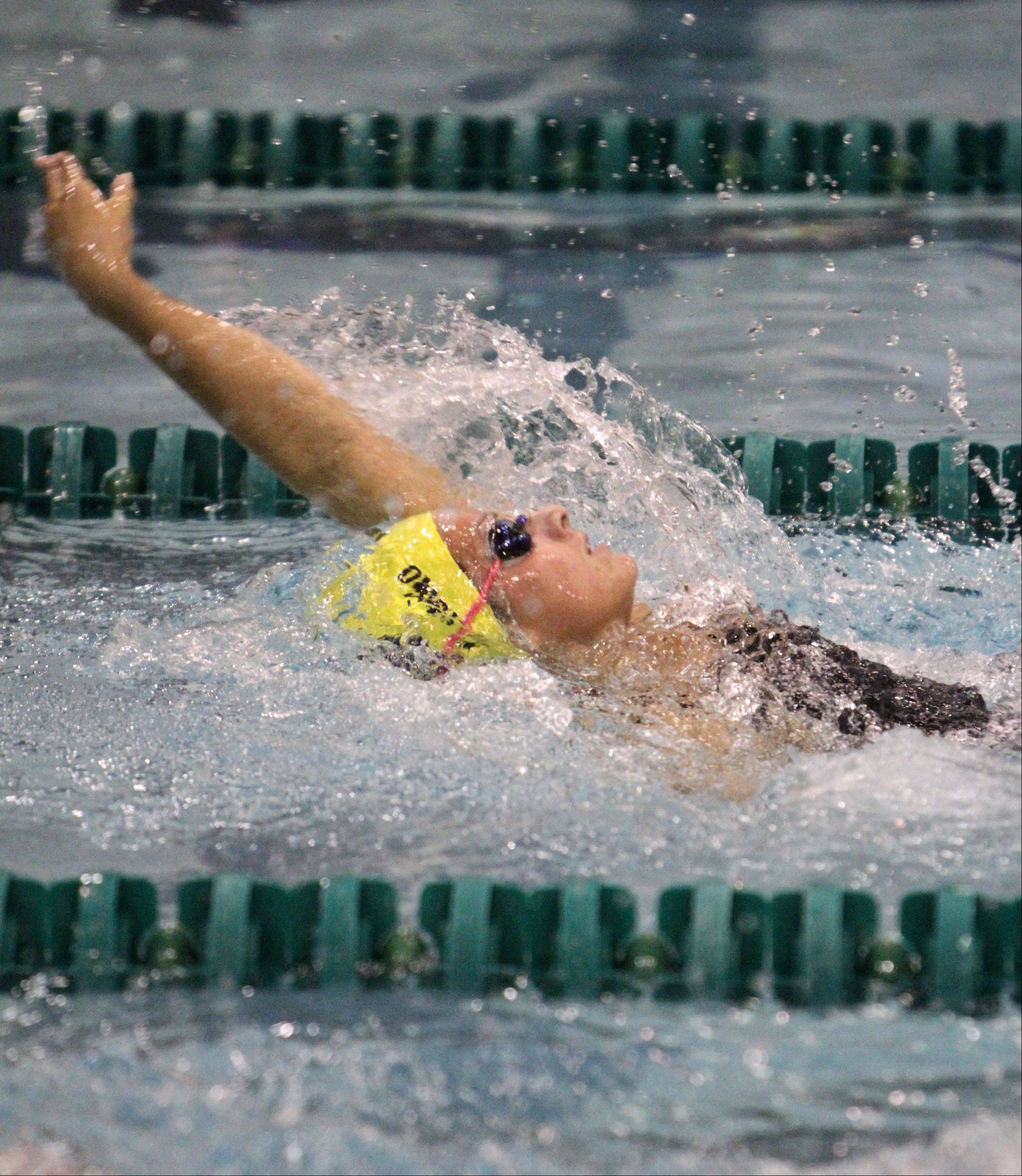 Neuqua Valley's Gia Dalesandro competes in the 100-yard backstroke at the IHSA state final preliminaries in Winnetka on Friday, November 18th.