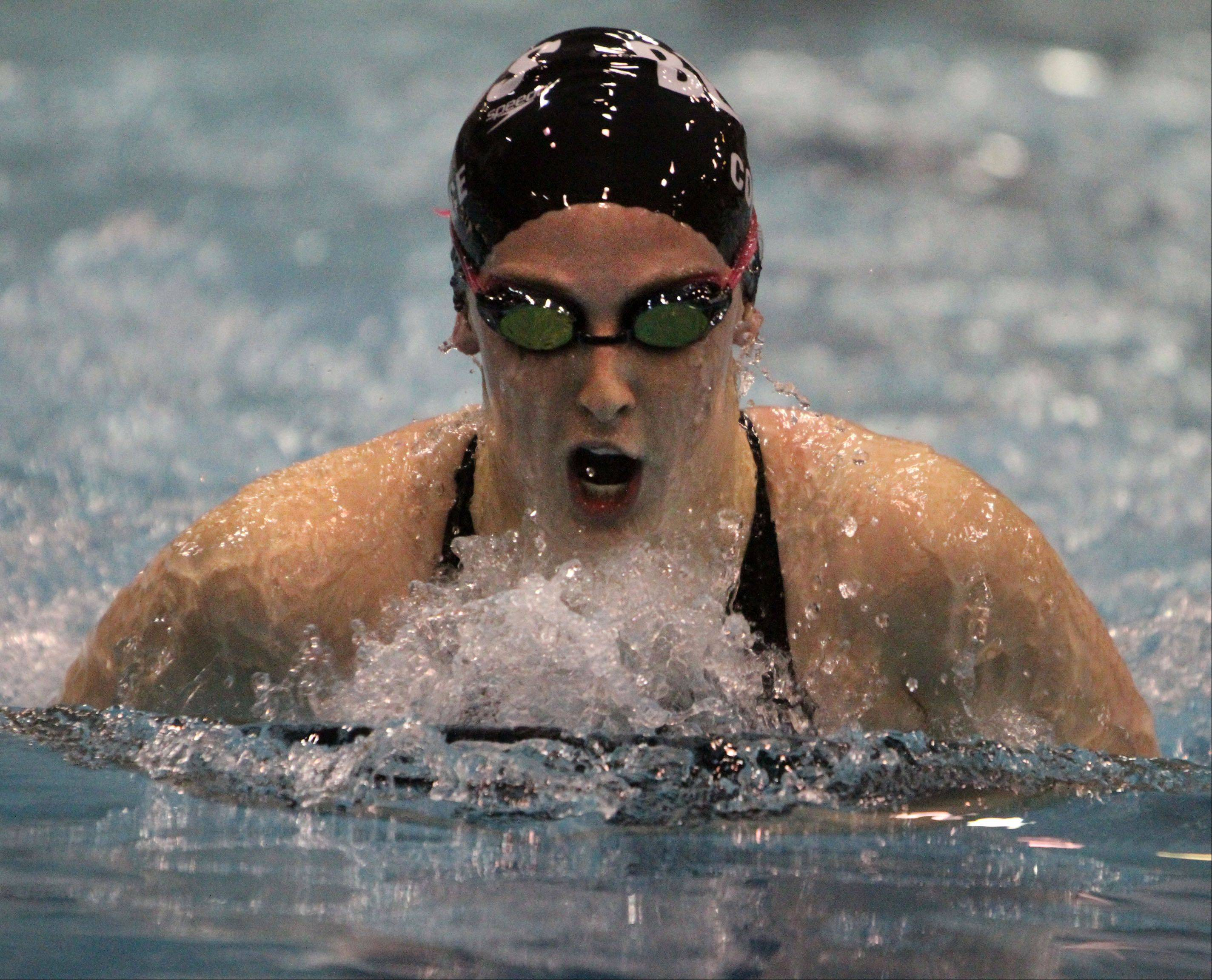 Rosary's Molly Coonce competes in the 100-yard breaststroke at the IHSA state final preliminaries in Winnetka on Friday, November 18th.