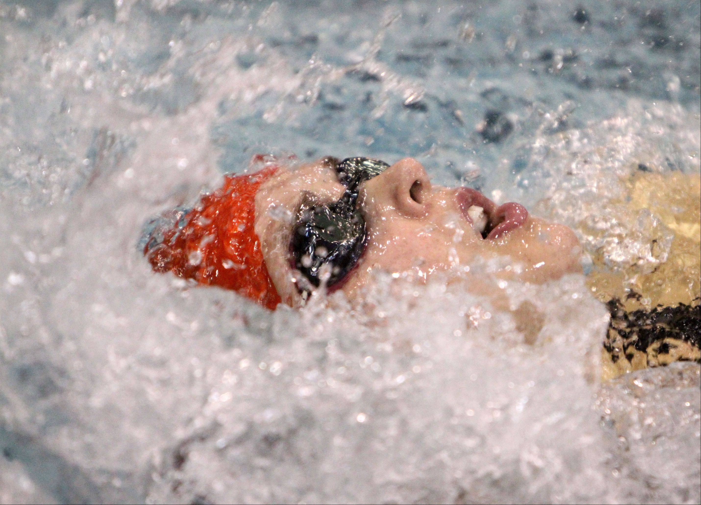 Hinsdale Central's Hannah Lillioja competes in the 100-yard backstroke.