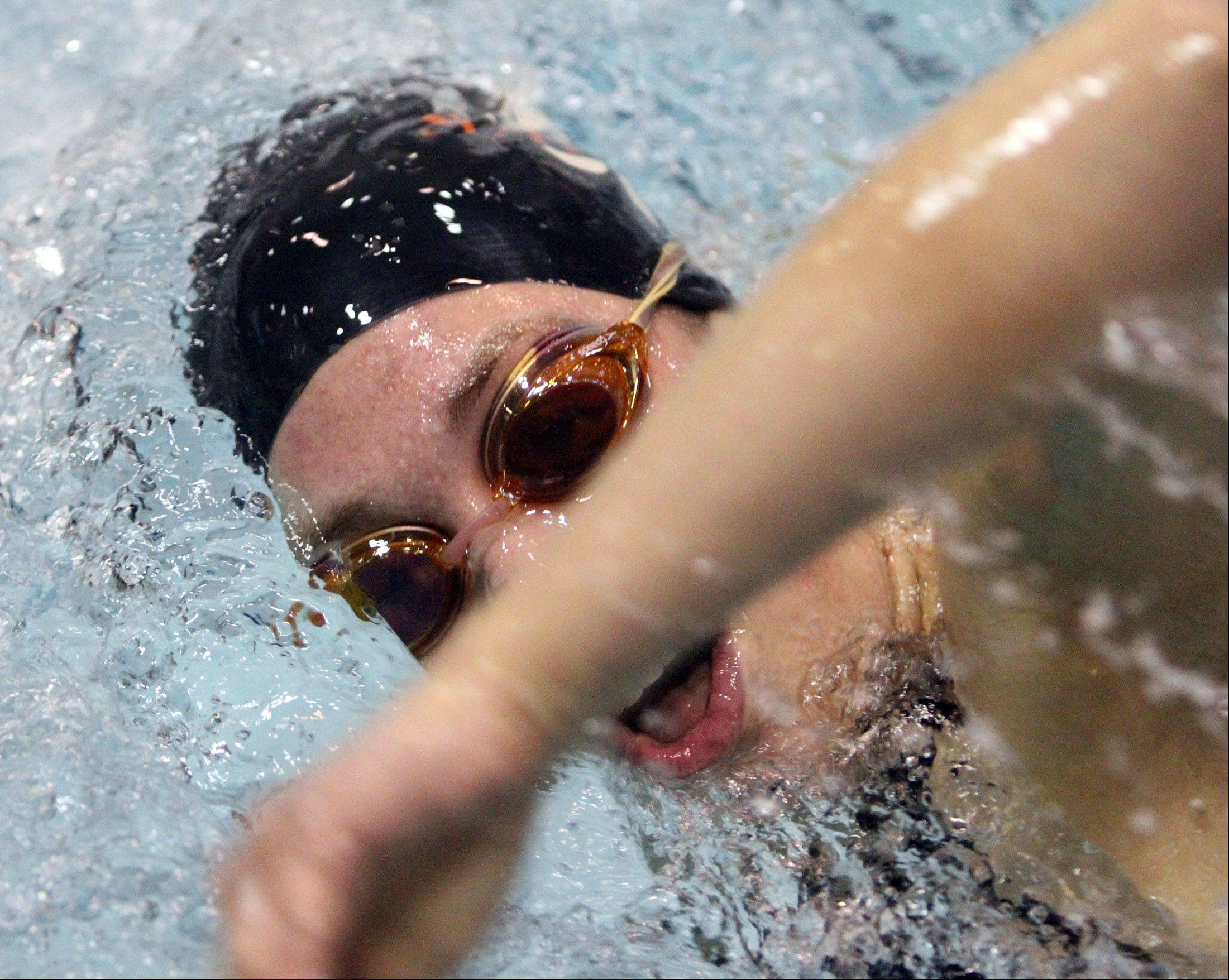 St. Charles East's Izzie Bindseil competes in the 200-yard freestyle at IHSA state final preliminaries in Winnetka on Friday, November 18th.