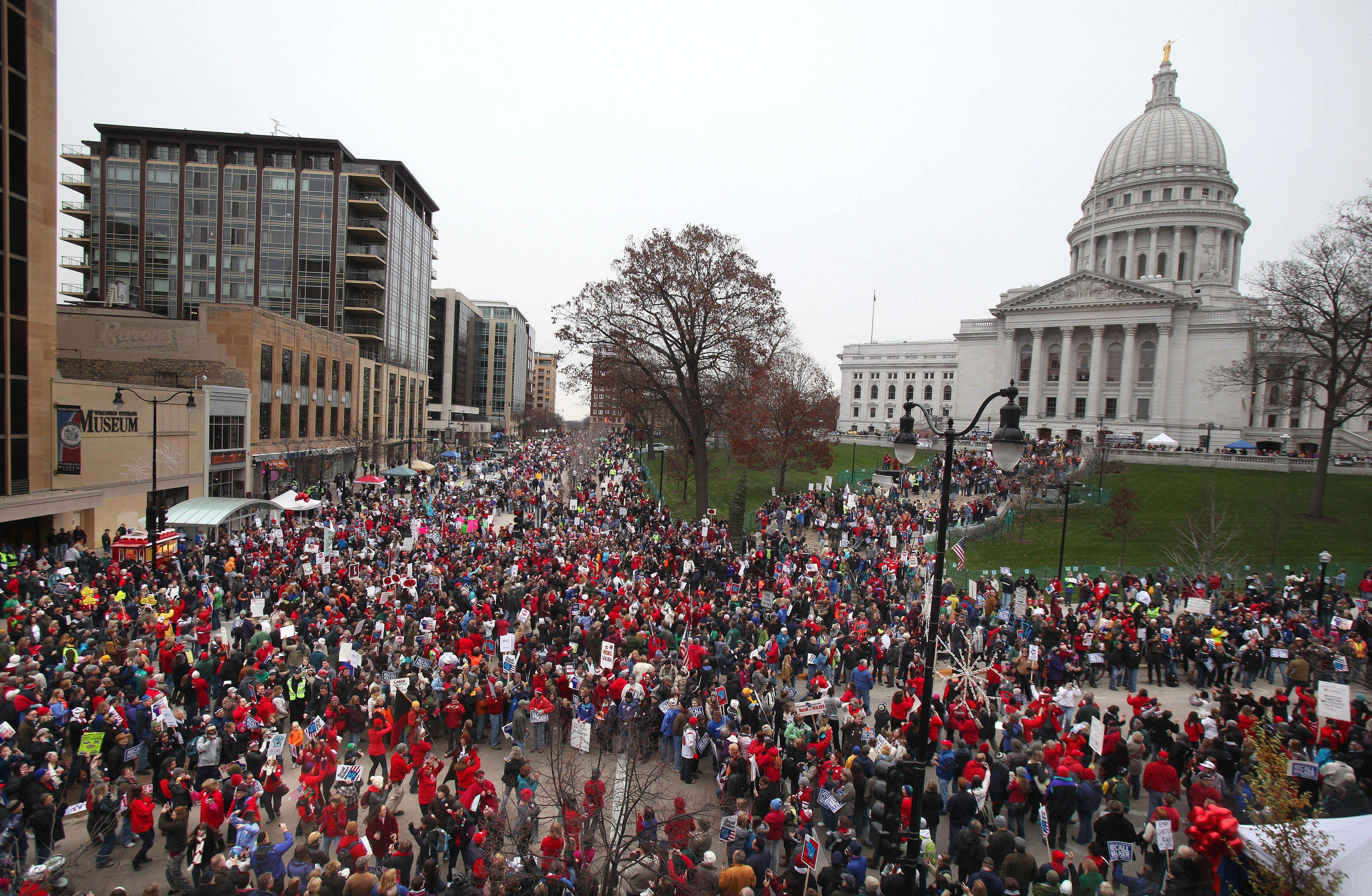 "Protesters gather Saturday for the ""We Are Wisconsin"" rally and petition signing for the recall of Governor Scott Walker."