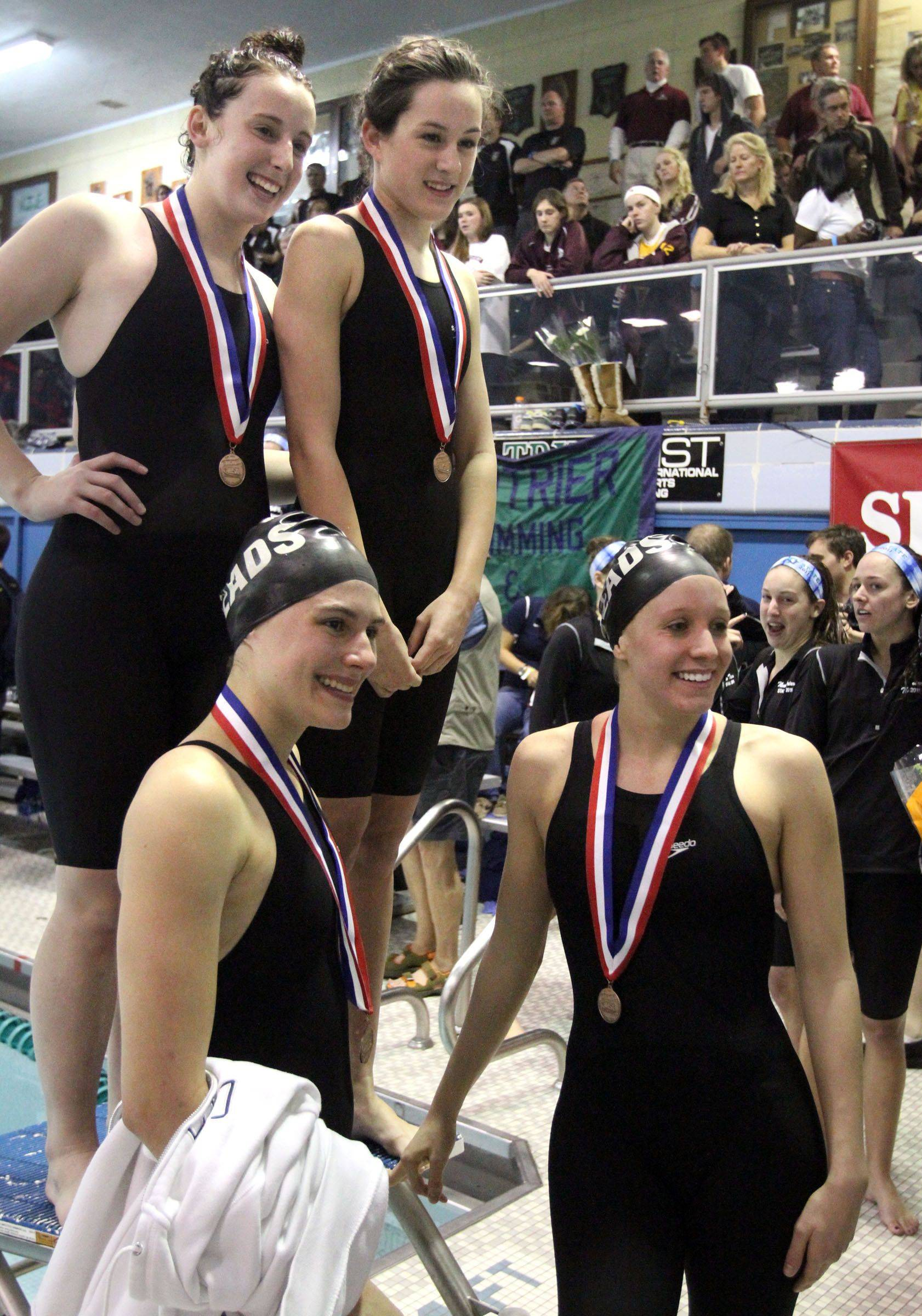 Rosary's Emily Launer, Rachel Burke, Molly Coonce, and Erin Hart placed seventh in the 400-yard freestyle relay at IHSA state championships in Winnetka on Saturday, November 19th.