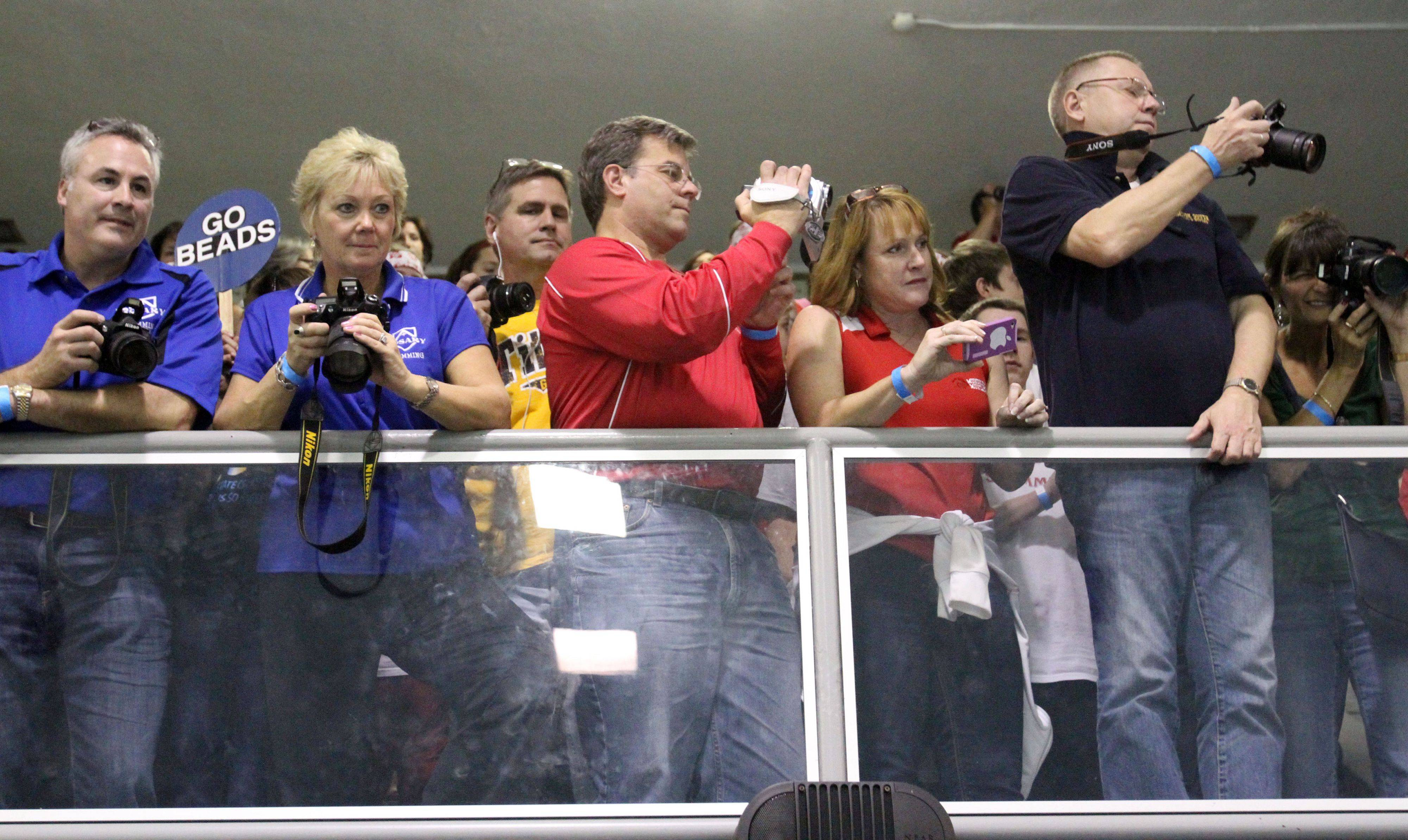 Parents in the upper-deck photographing the IHSA state championships in Winnetka on Saturday, November 19th.