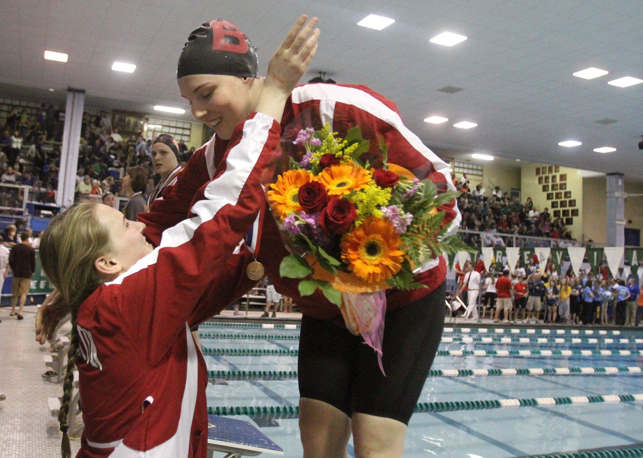 Barrington's Erika Elliott placed eighth in the 50-yard freestyle and gets a hug from her sister Danielle at IHSA state championships in Winnetka on Saturday, November 19th.