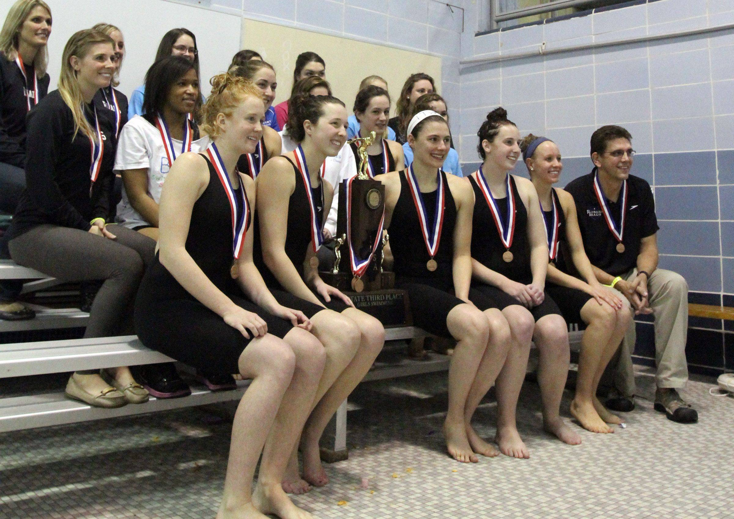 Rosary swim team with the third place team trophy at the IHSA state championships in Winnetka on Saturday, November 19th.