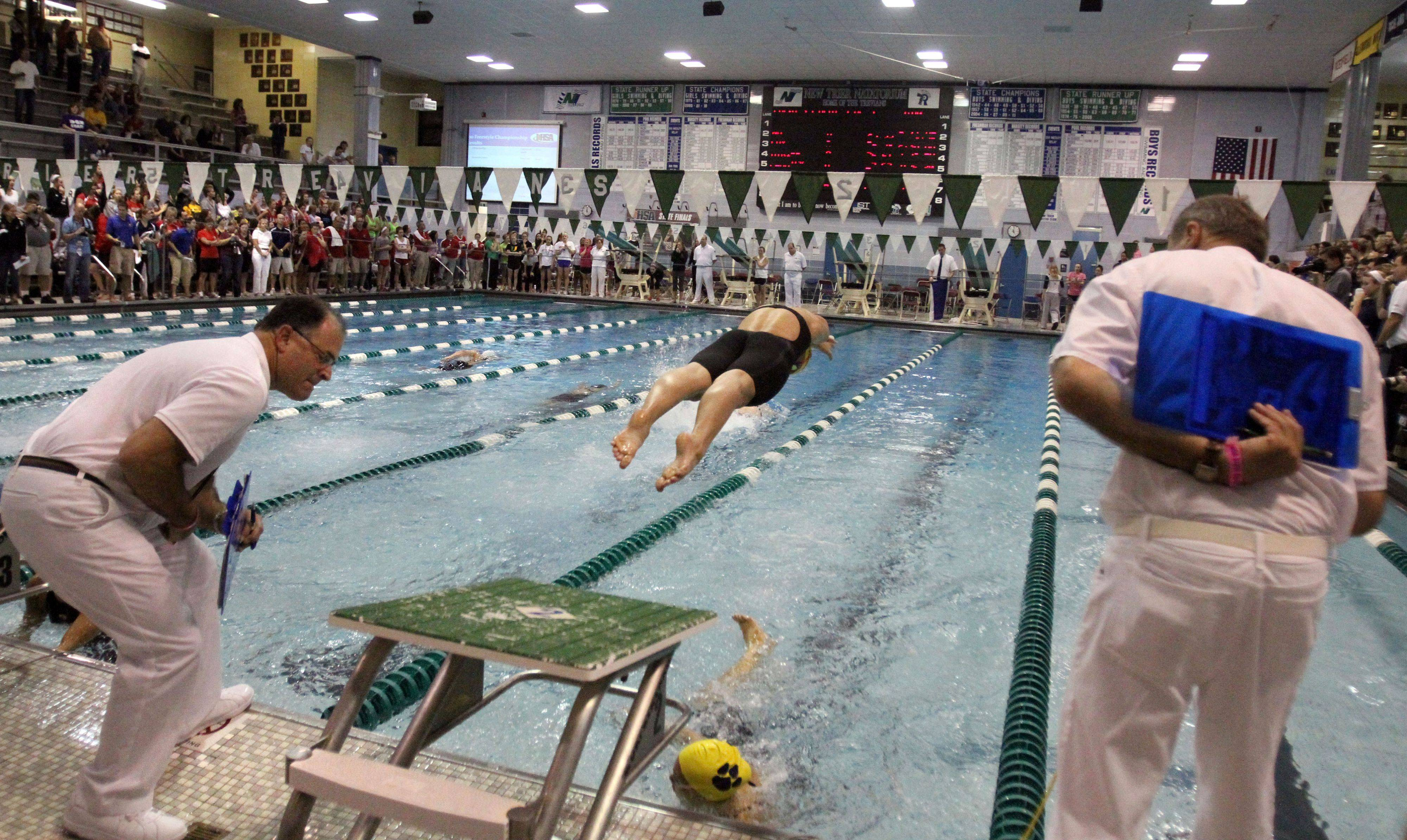 Neuqua Valley relay team competes in the 400-yard freestyle relay at IHSA state championships in Winnetka on Saturday, November 19th.