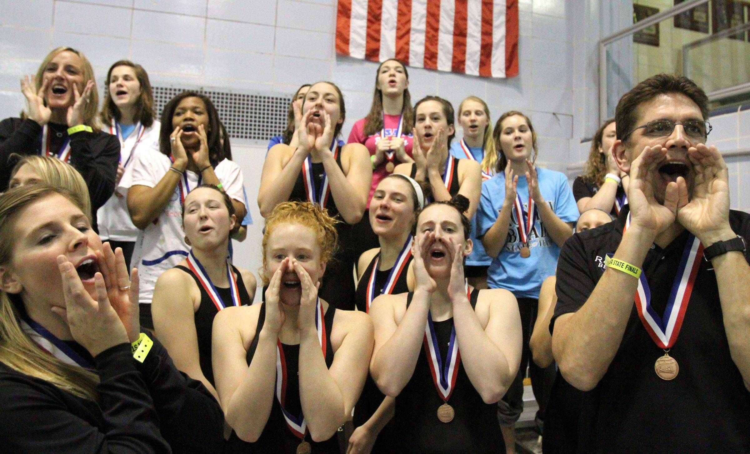 The Rosary swim team, after placing third in state, cheer on the first and second place teams at the IHSA state championships in Winnetka on Saturday, November 19th.