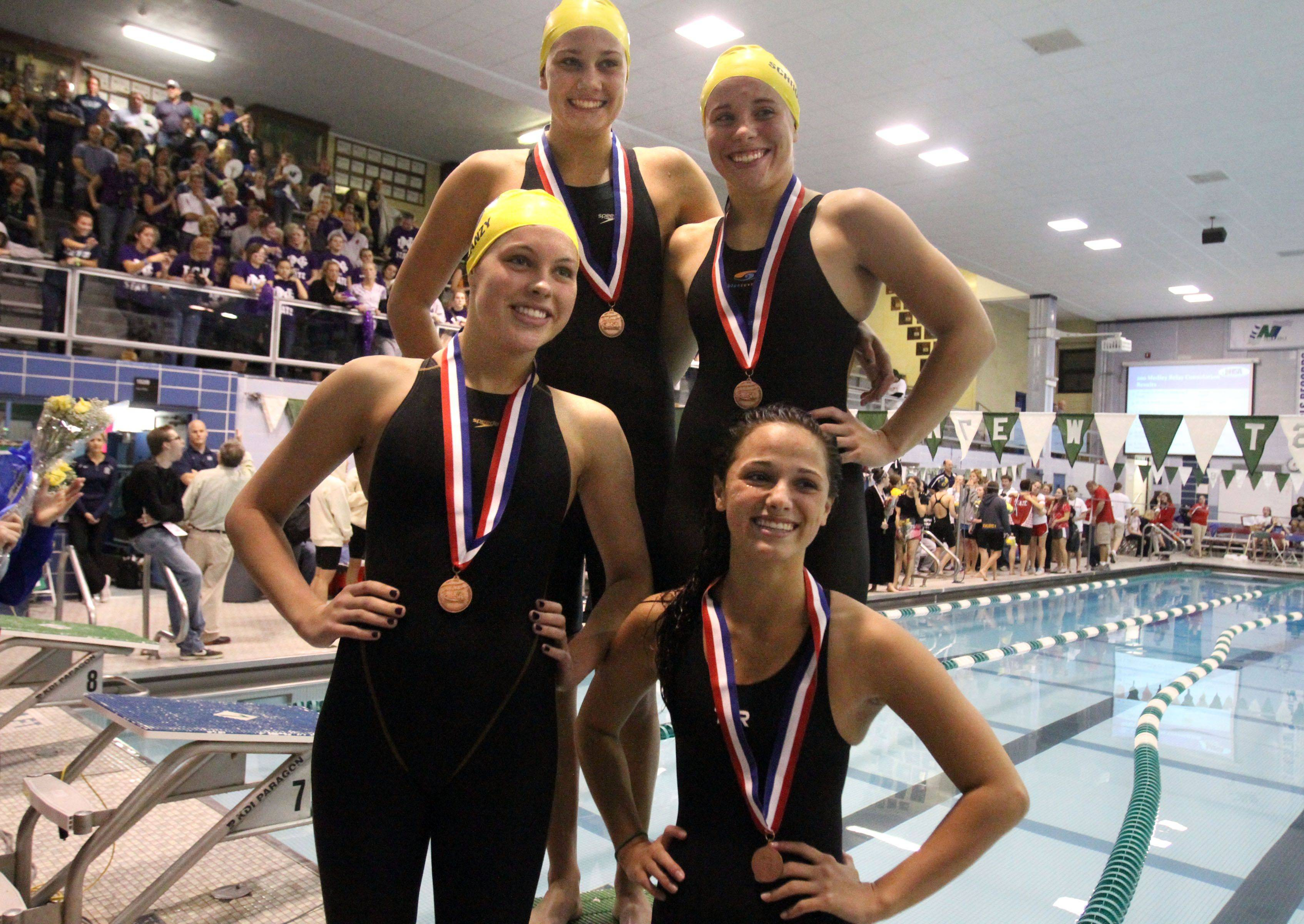Neuqua Valley's Riley Schroedter, Tara Blanzy, Megan Childs, and Gia Dalesandro placed sixth in the 400-yard freestyle relay at IHSA state championships in Winnetka on Saturday, November 19th.