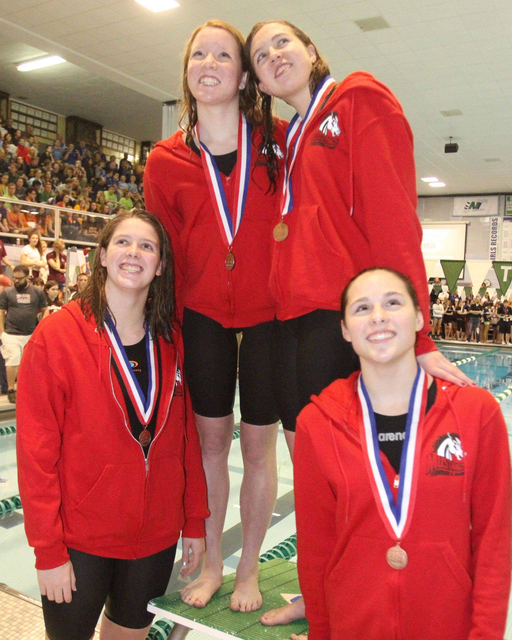 Mundelien's Erin Falconer, Jennifer Kordik, Meghan Falconer, and Karrie Kozokar placed 12th in the 200-yard medley relay at the IHSA state championships in Winnetka on Saturday, November 19th.