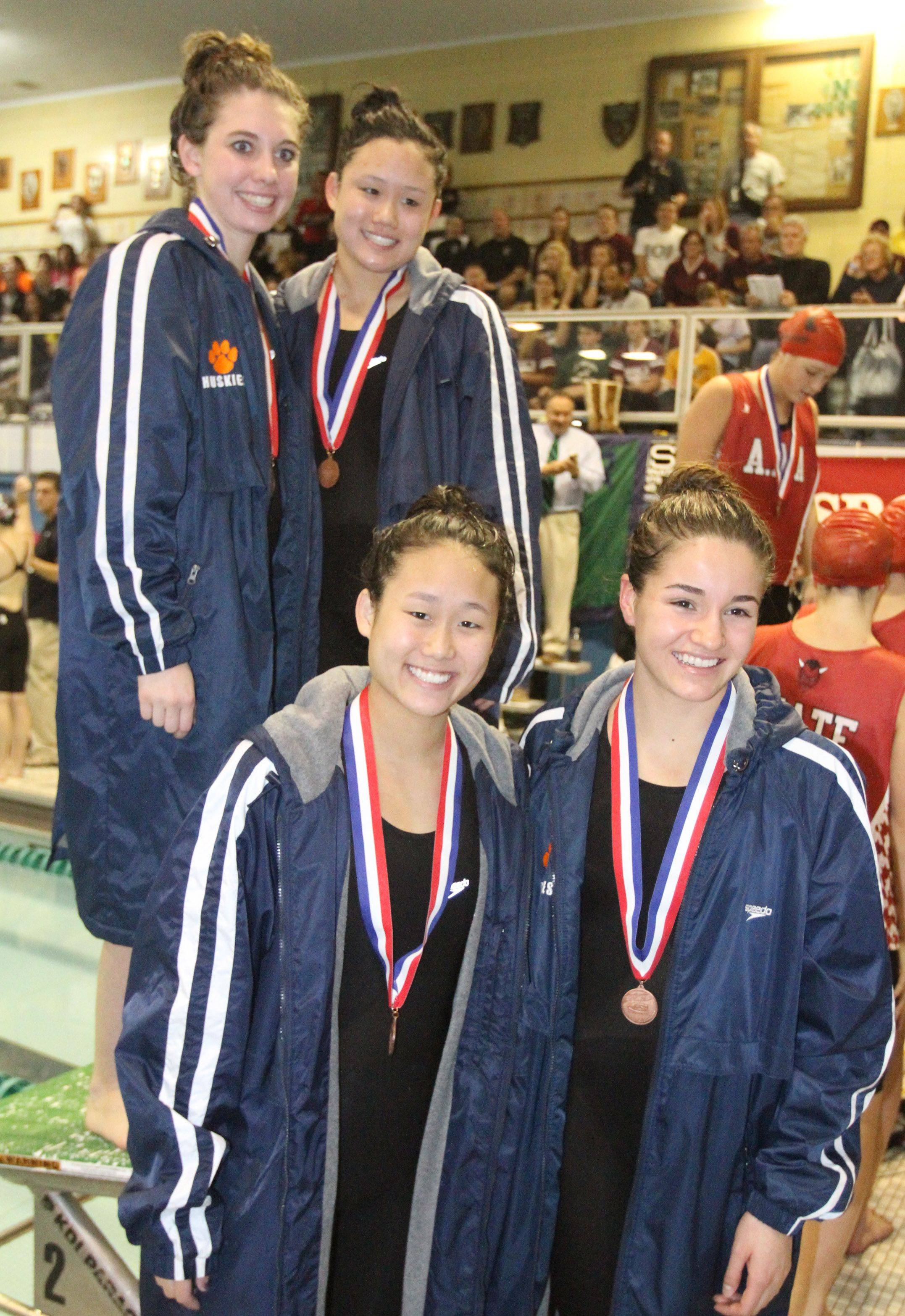 Naperville North's Michelle Law, Rachel Prorok, Jen Law, and Becca Bogle finished eighth in the 200-yard medley relay at the IHSA state championships in Winnetka on Saturday, November 19th.