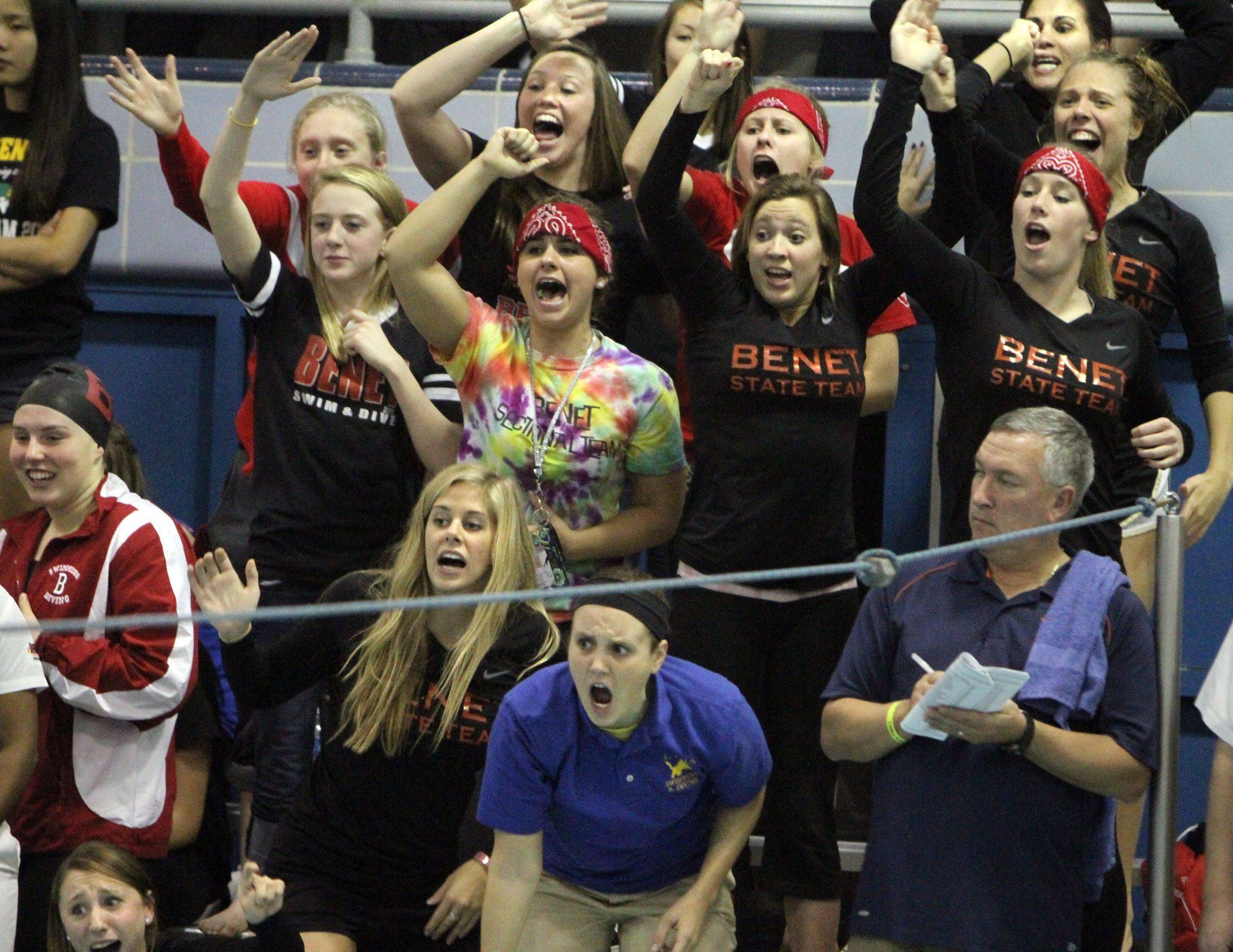 Benet Academy cheers on Cristina Favia as she placed seventh in the 500-yard freestyle at IHSA state championships in Winnetka on Saturday, November 19th.