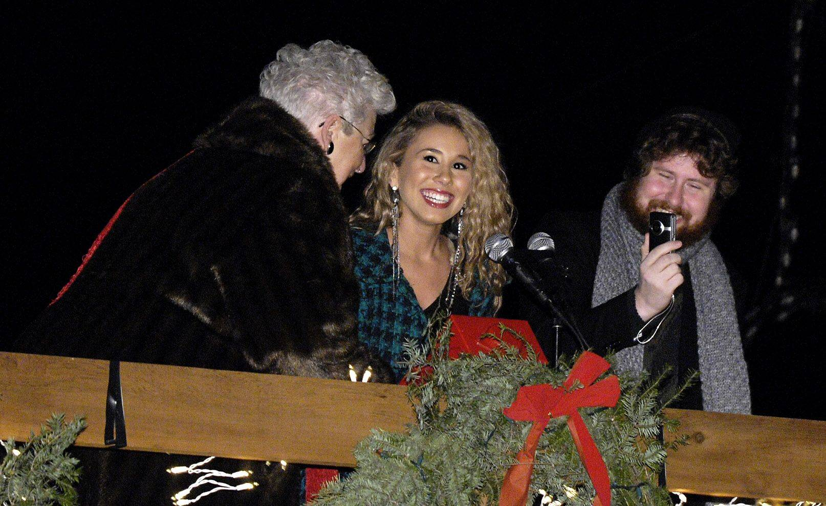 "Wheeling Village President Judy Abruscato and ""American Idol"" finalist Haley Reinhart flip the switch to light up the Christmas lights Sunday evening at Friendship Park in Wheeling. Haley Reinhart was accompanied by fellow ""American Idol"" contestant Casey Abrams."