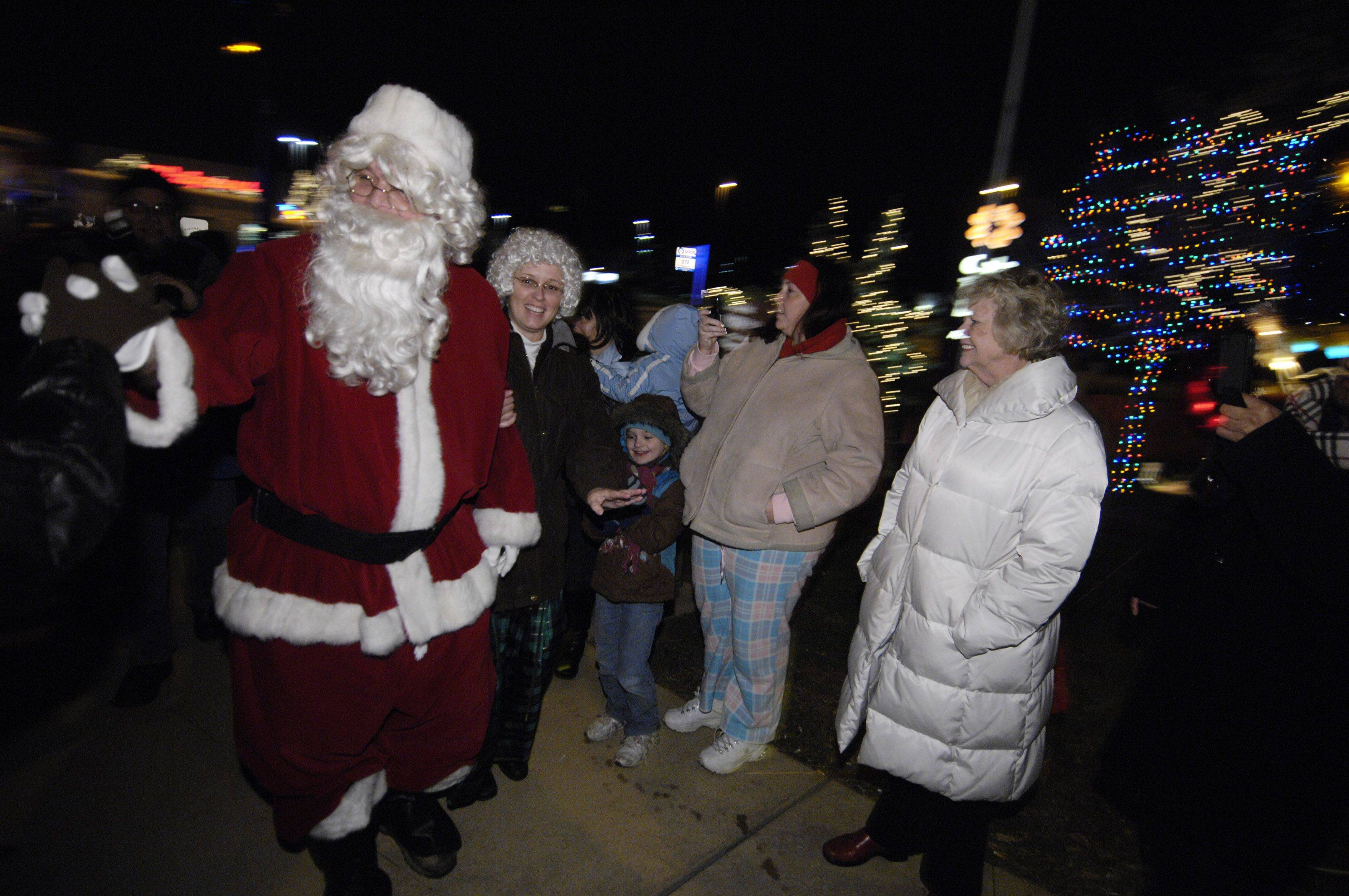 Mr. and Mrs. Claus visit the Christmas lighting celebration Sunday evening at Friendship Park in Wheeling.