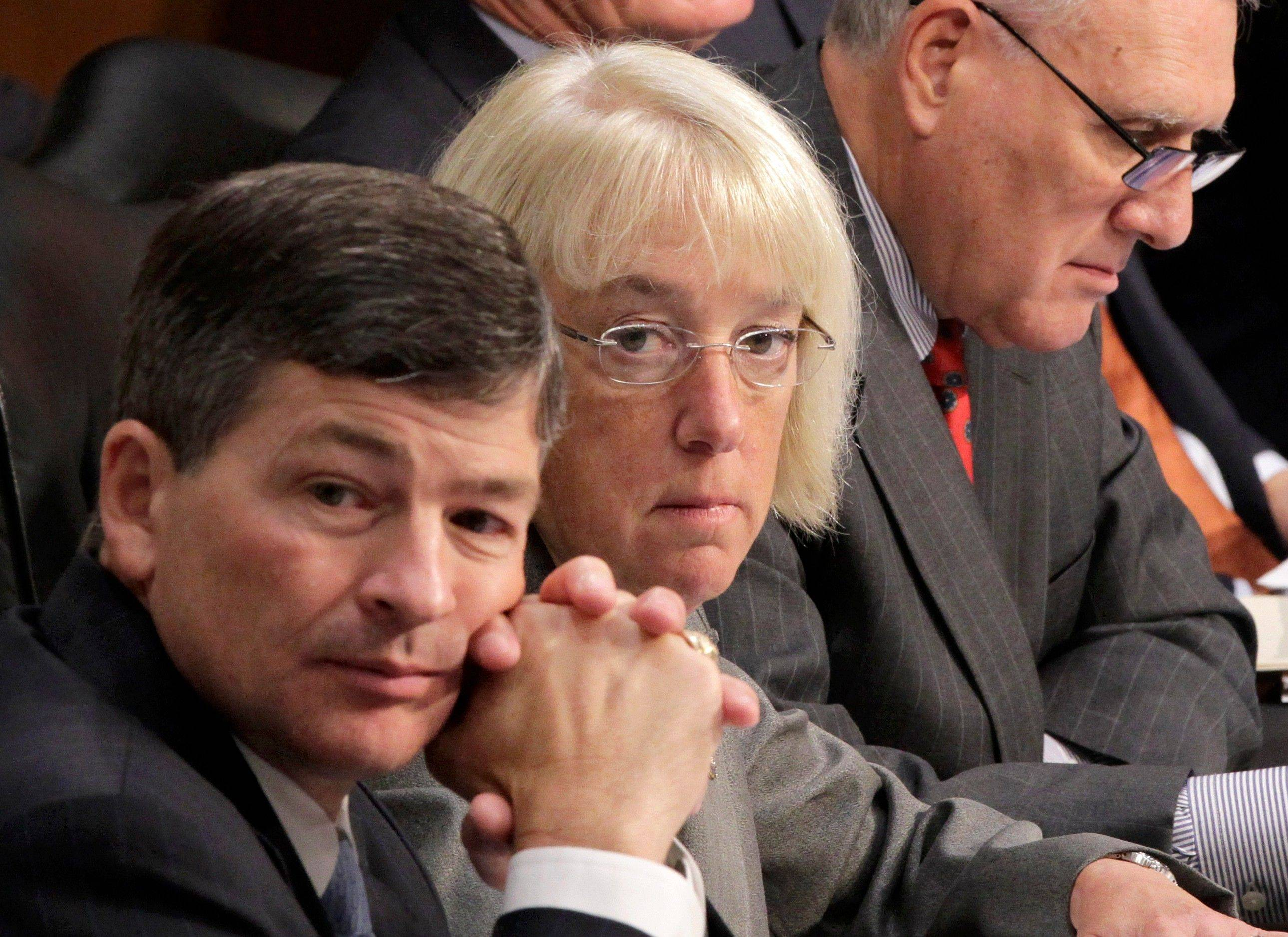 Supercommittee co-chairs Rep. Jeb Hensarling, a Texas Republican, left, and Sen. Patty Murray, a Washington Democrat, center, seen above on Sept. 13, appear ready to admit today that the panel has failed to agree on a debt reduction plan.