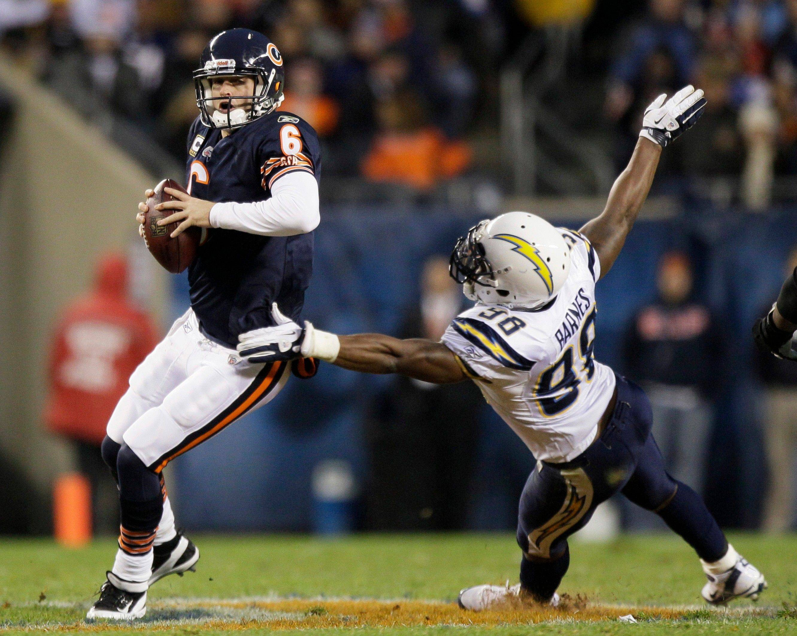 Bears quarterback Jay Cutler looks to pass while under pressure from Chargers linebacker Antwan Barnes in the first half Sunday at Soldier Field.