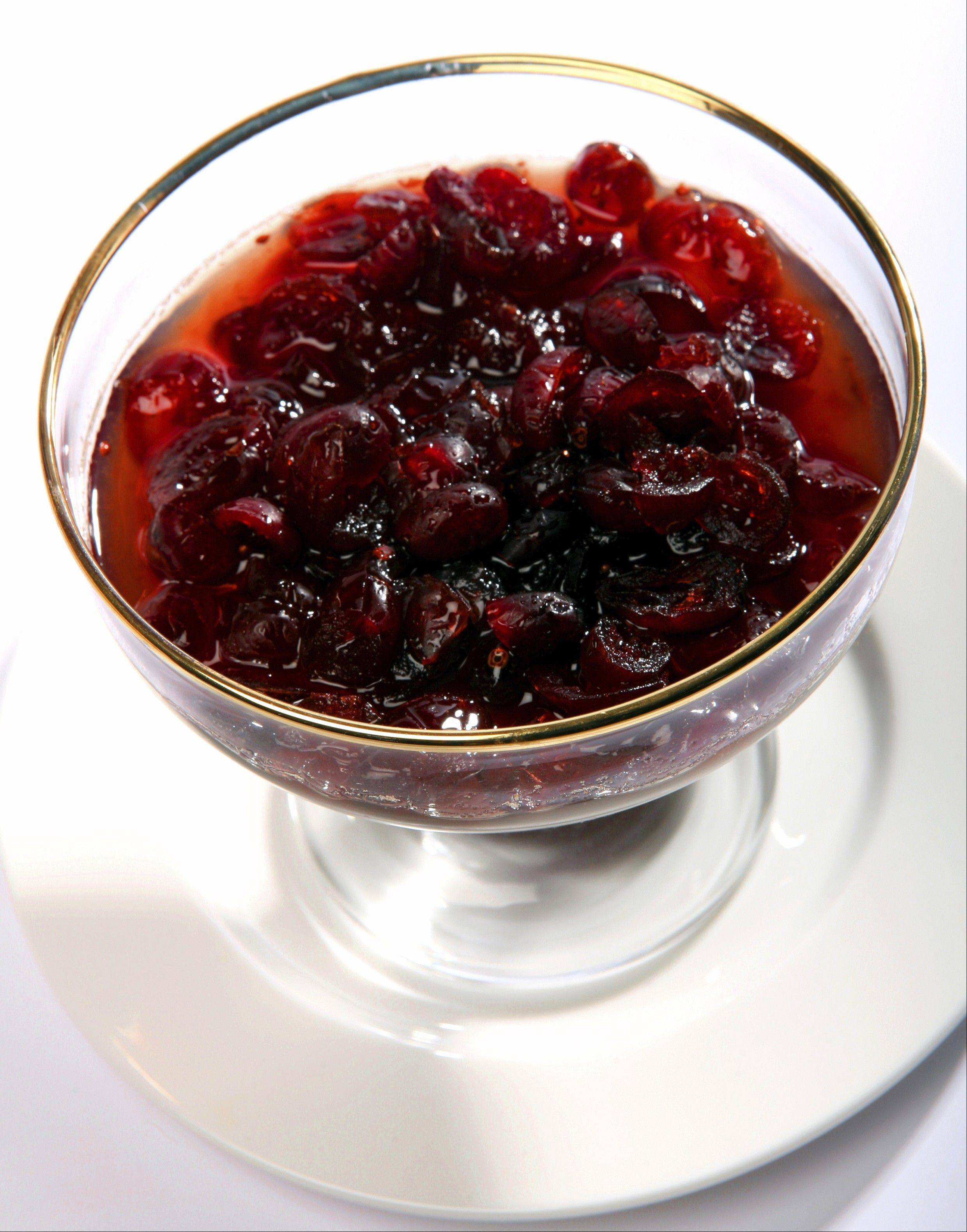 A glass bowl containing cranberry sauce, traditionally served with turkey at thanksgiving and Christmas