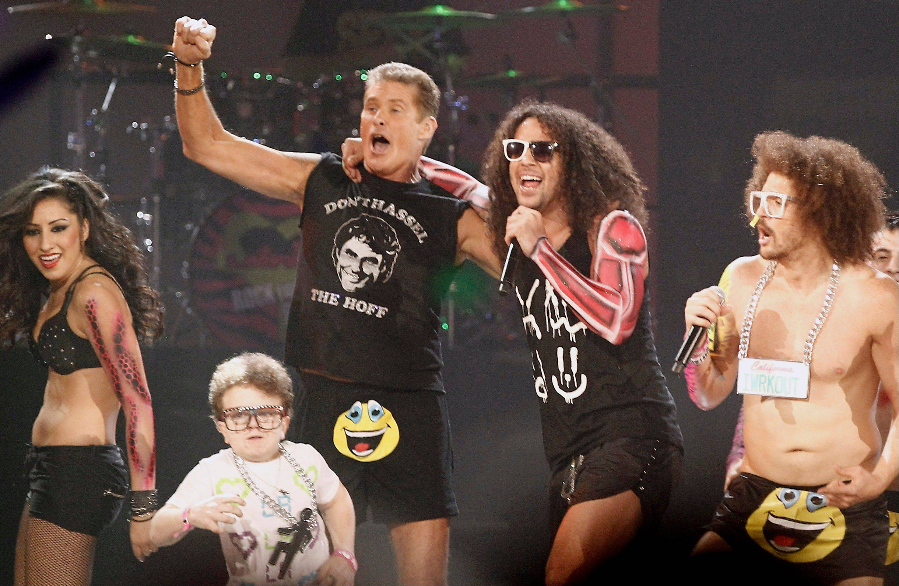 Keenan Cahill, David Hasselhoff, SkyBlu, and Redfoo are seen onstage as the music group LMFAO performs onstage at the 39th Annual American Music Awards on Sunday, Nov. 20, 2011 in Los Angeles.