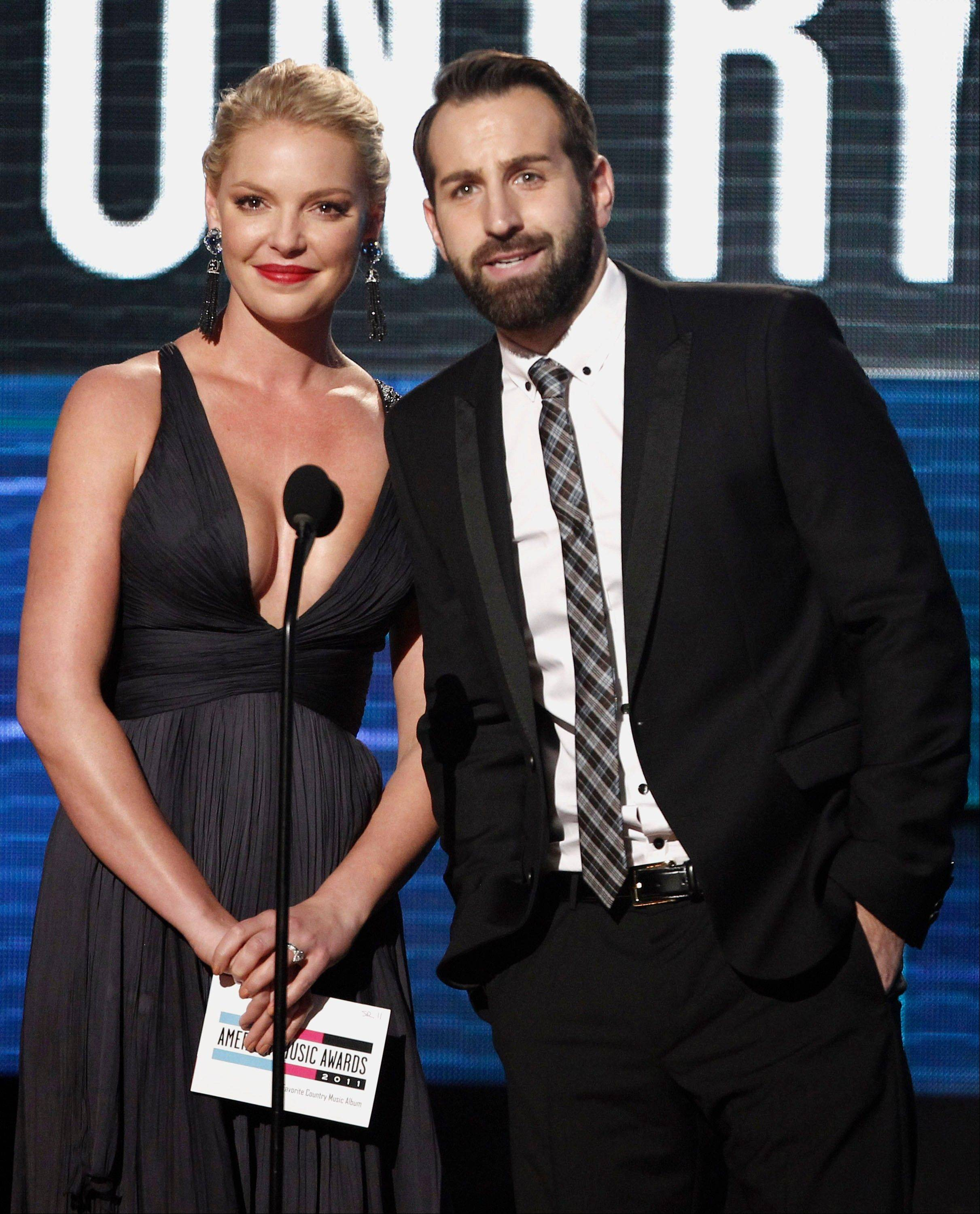 Katherine Heigl and Josh Kelley are seen onstage at the 39th Annual American Music Awards on Sunday, Nov. 20, 2011 in Los Angeles.