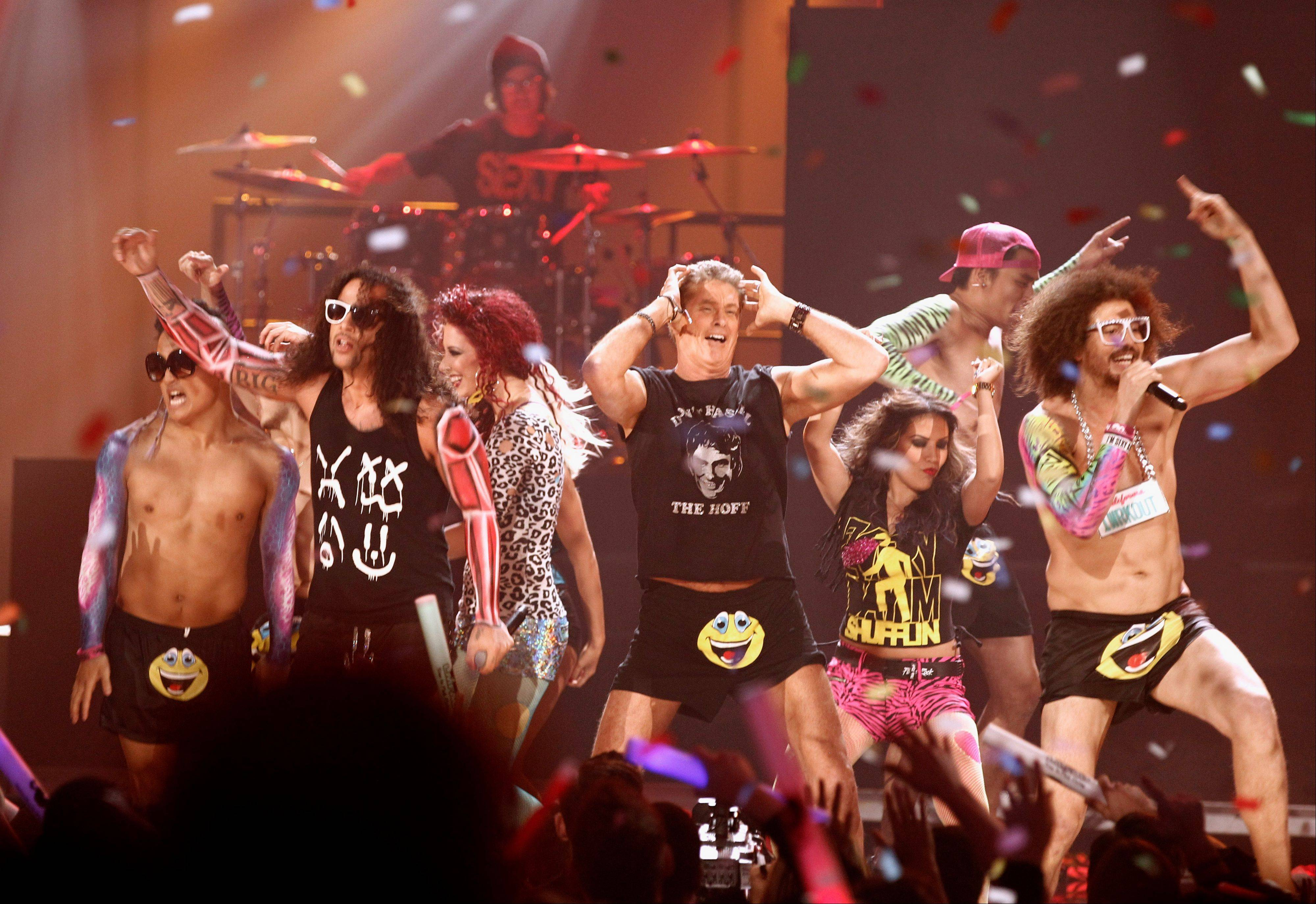 David Hasselhoff, center, dances onstage with LMFAO at the 39th Annual American Music Awards on Sunday, Nov. 20, 2011 in Los Angeles.