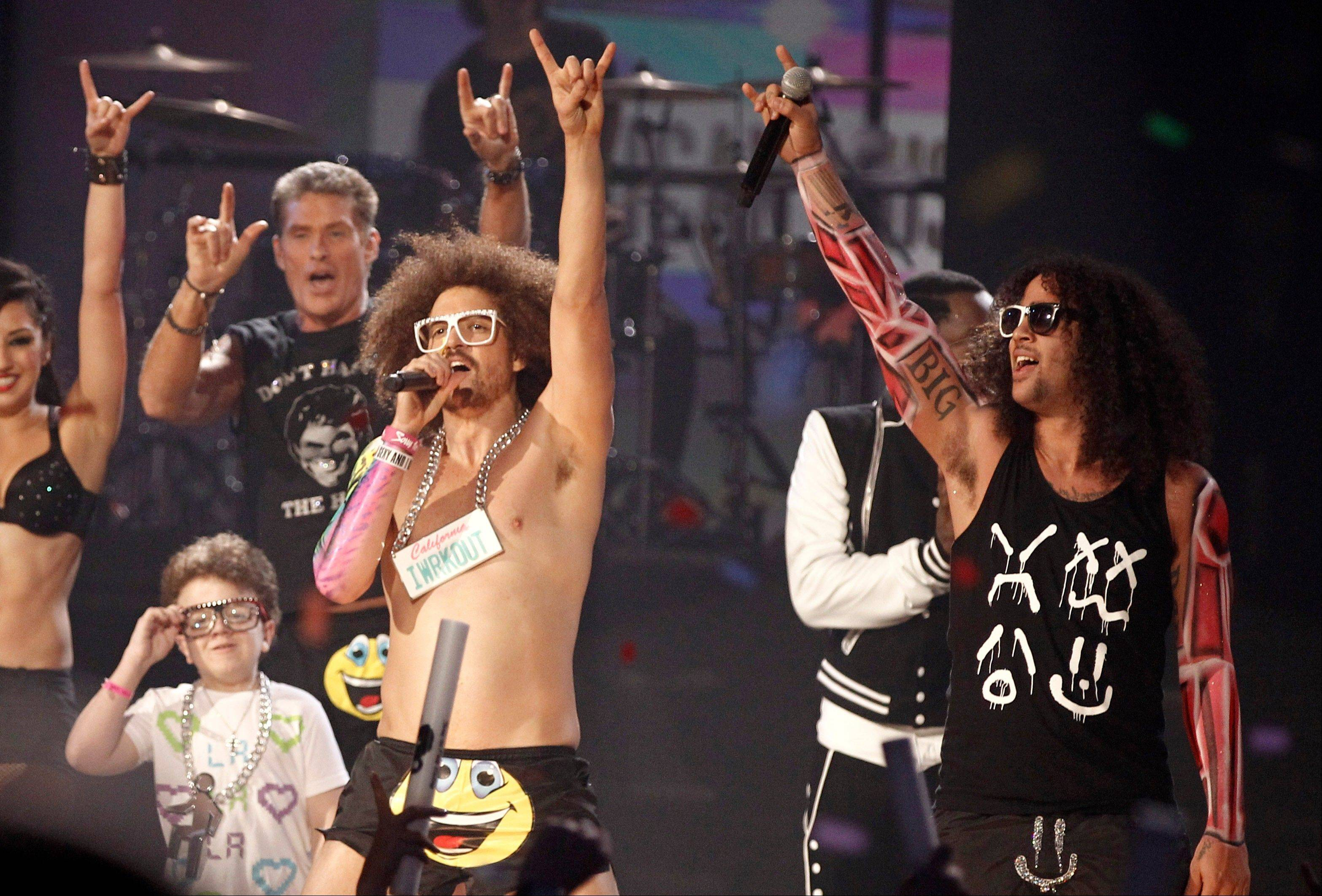 Keenan Cahill and David Hasselhoff are seen onstage as Redfoo and SkyBlu of the music group LMFAO perform onstage at the 39th Annual American Music Awards on Sunday, Nov. 20, 2011 in Los Angeles.