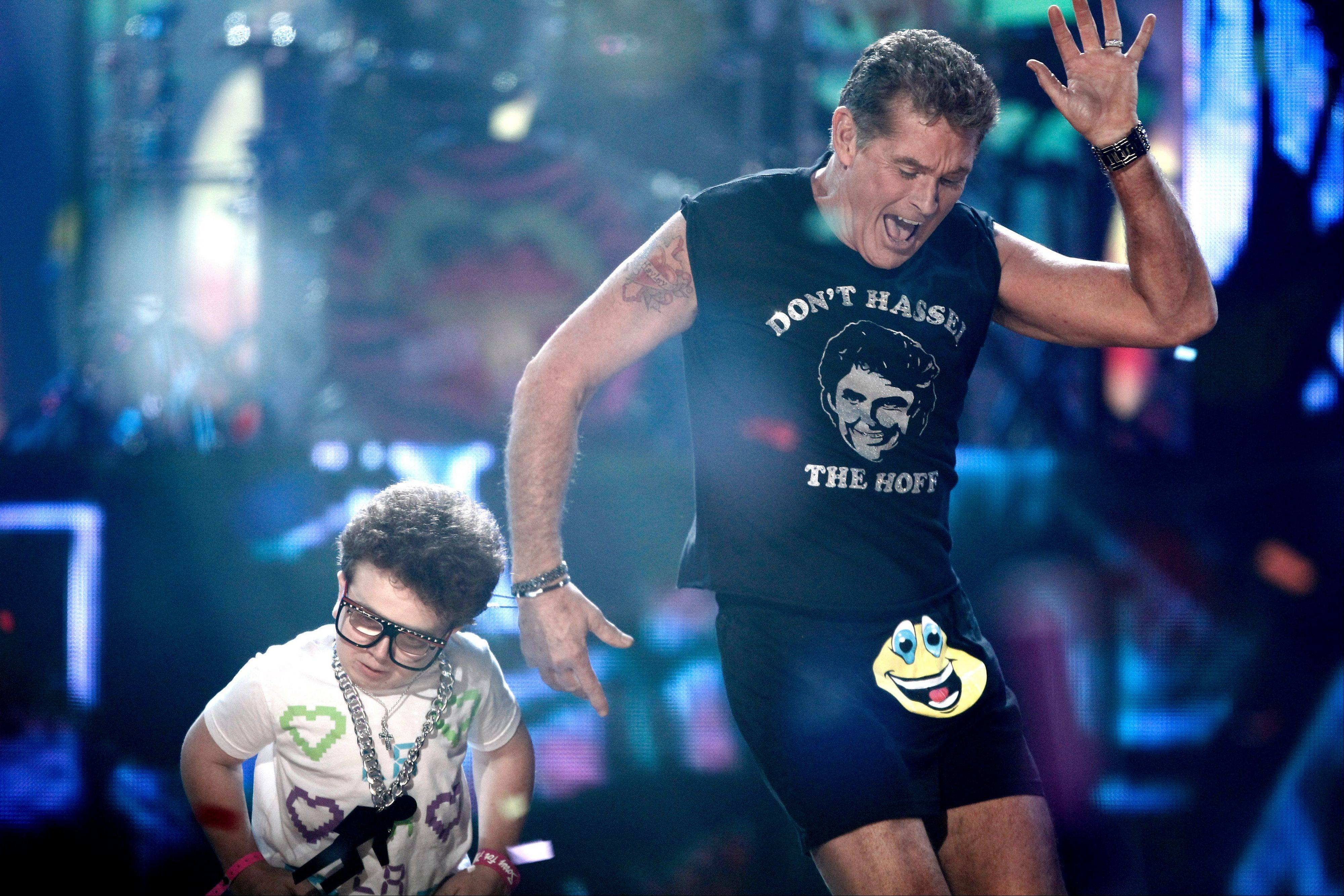David Hasselhoff, right, and Keenan Cahill dance onstage while LMFAO performs at the 39th Annual American Music Awards on Sunday, Nov. 20, 2011 in Los Angeles.