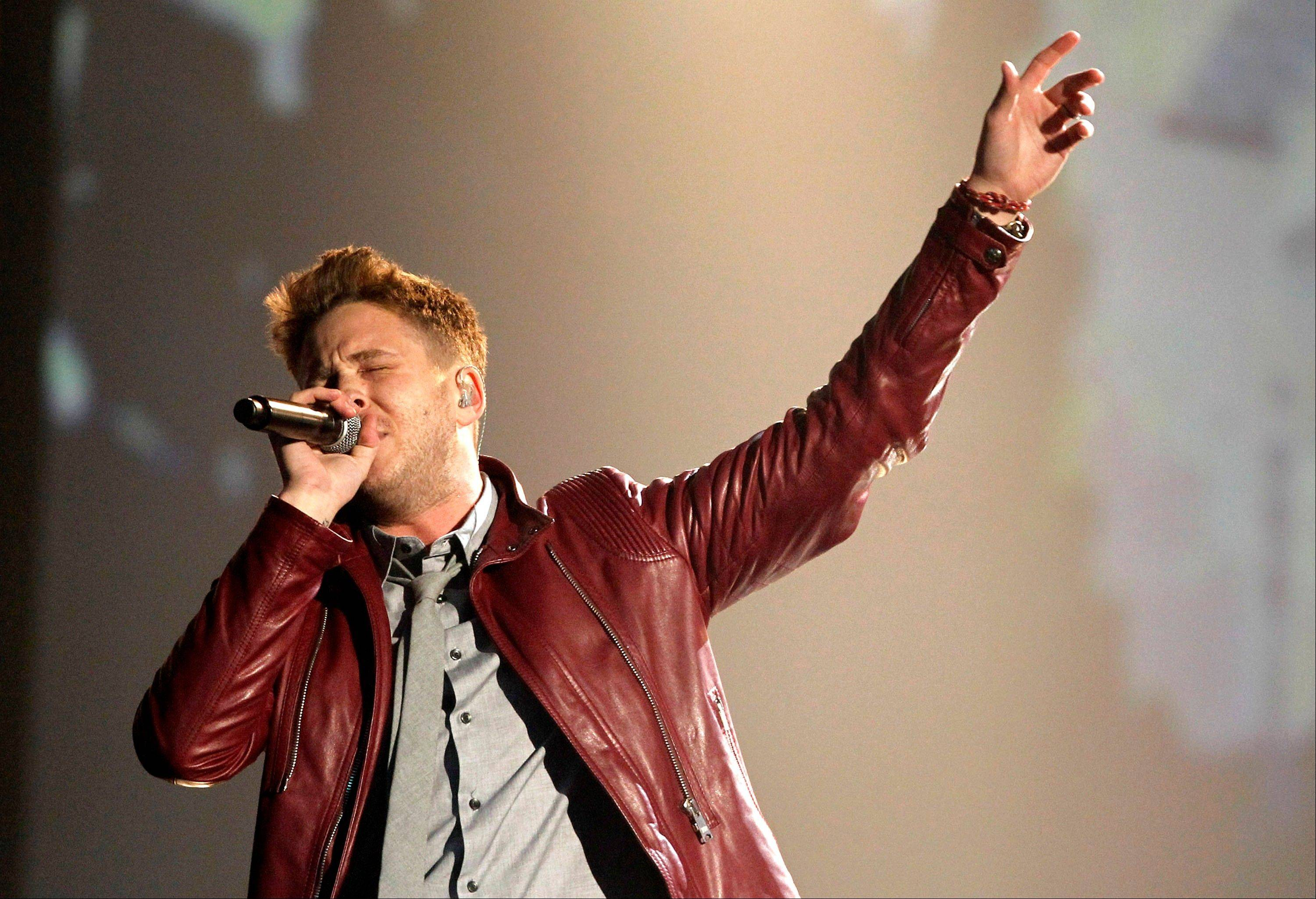 Ryan Tedder and the band OneRepublic perform at the 39th Annual American Music Awards on Sunday, Nov. 20, 2011 in Los Angeles.