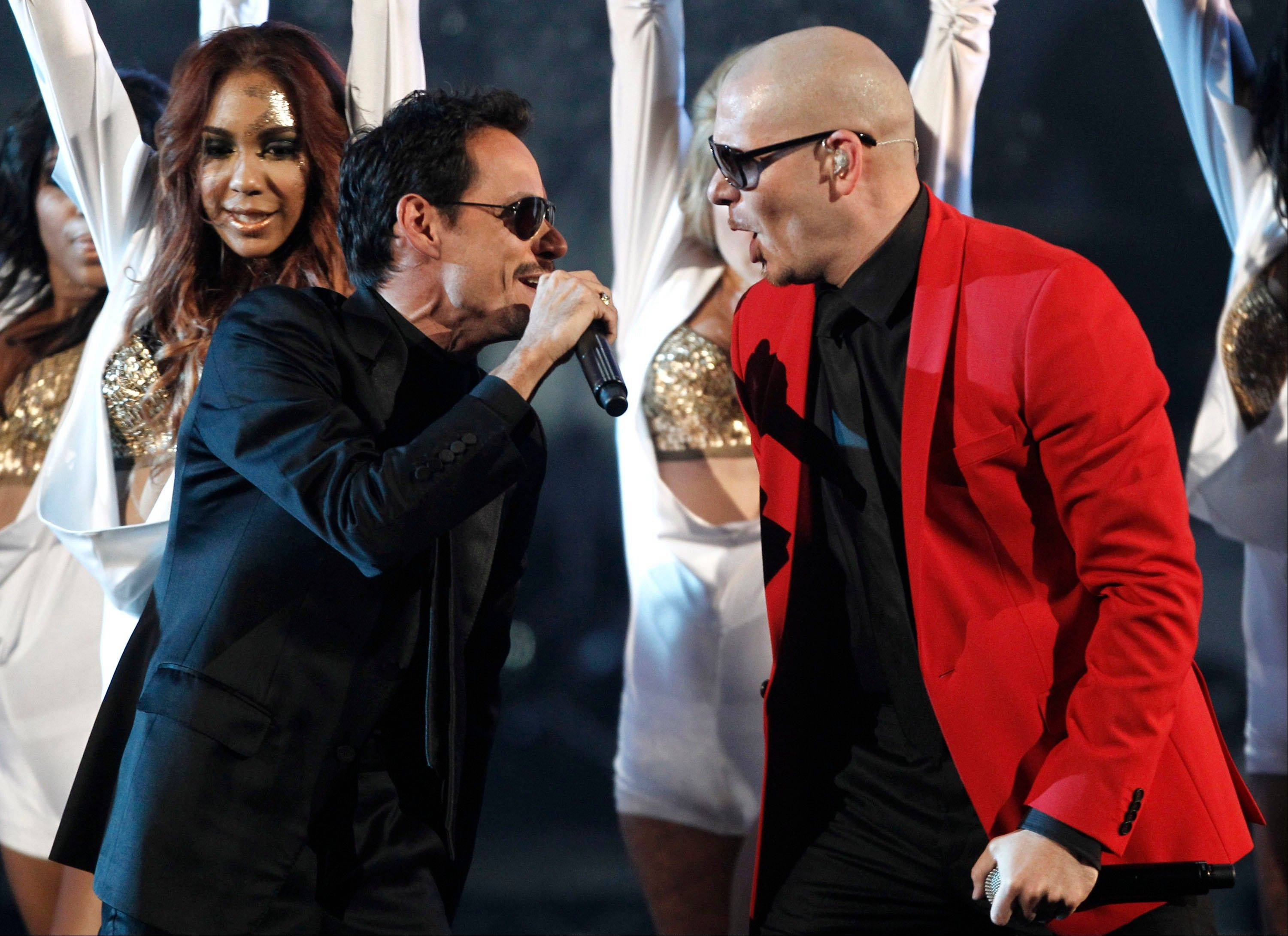 Marc Anthony, left, and Pittbull perform at the 39th Annual American Music Awards on Sunday, Nov. 20, 2011 in Los Angeles.