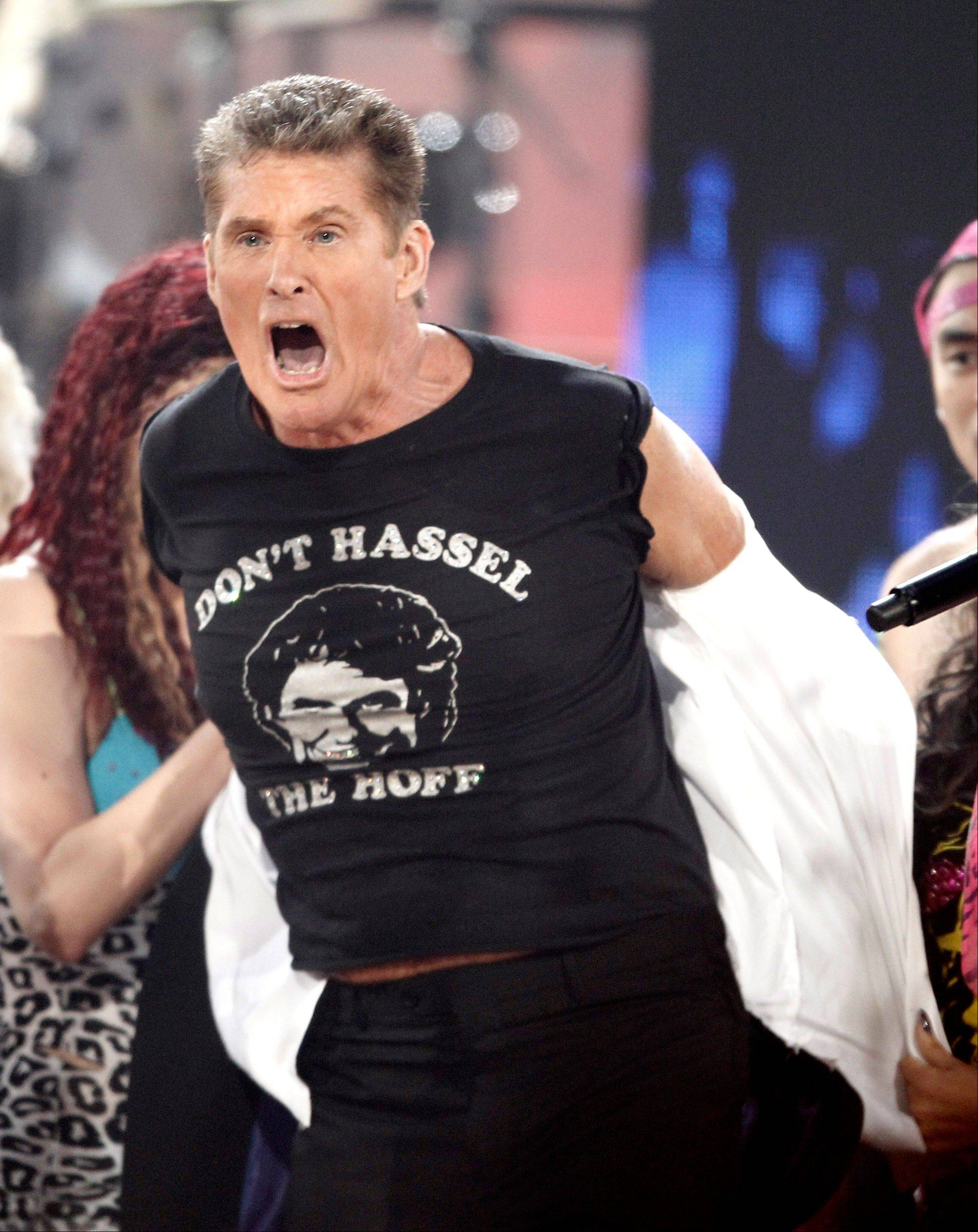 David Hasselhoff dances onstage while LMFAO performs at the 39th Annual American Music Awards on Sunday, Nov. 20, 2011 in Los Angeles.