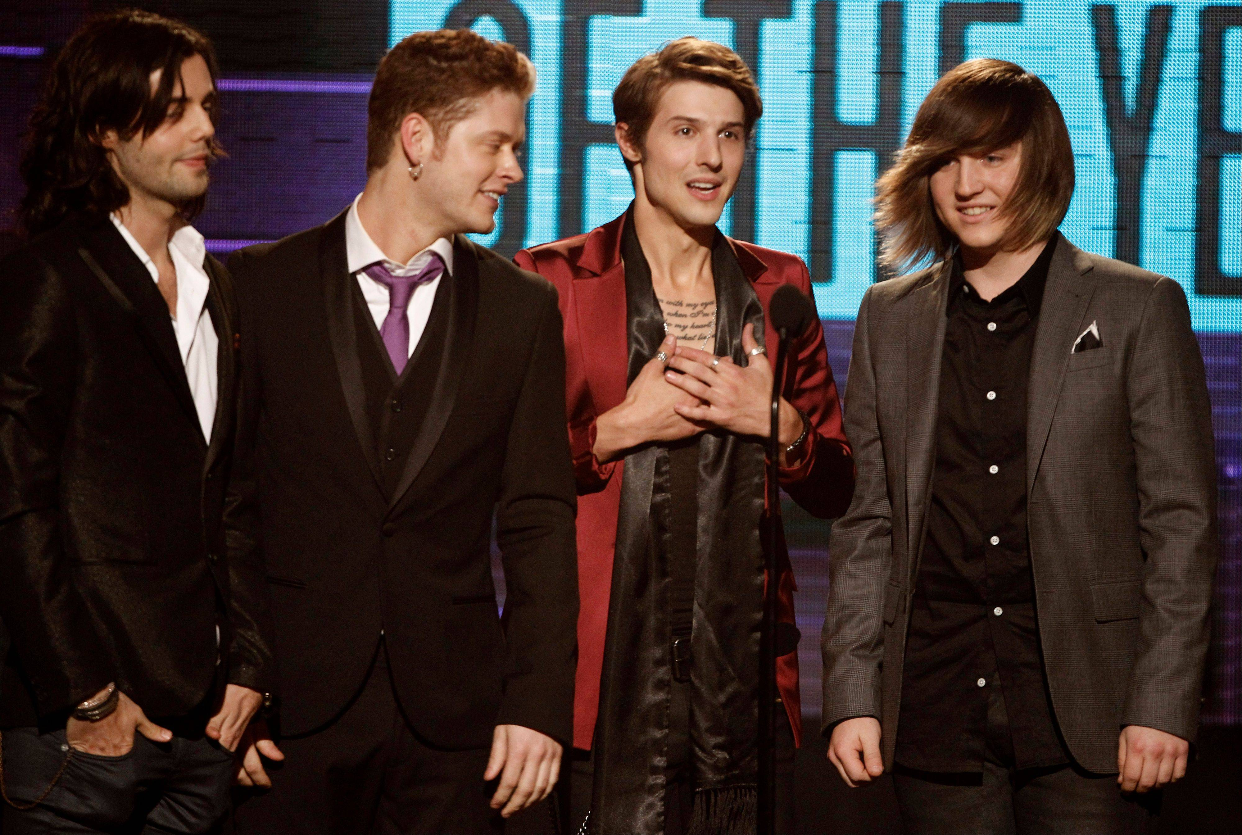The band Hot Chelle Rae, from left, Ian Keaggy, Nash Overstreet, Ryan Follese, and Jamie Follese, accept the Sprint new artist of the year award at the 39th Annual American Music Awards on Sunday, Nov. 20, 2011 in Los Angeles.