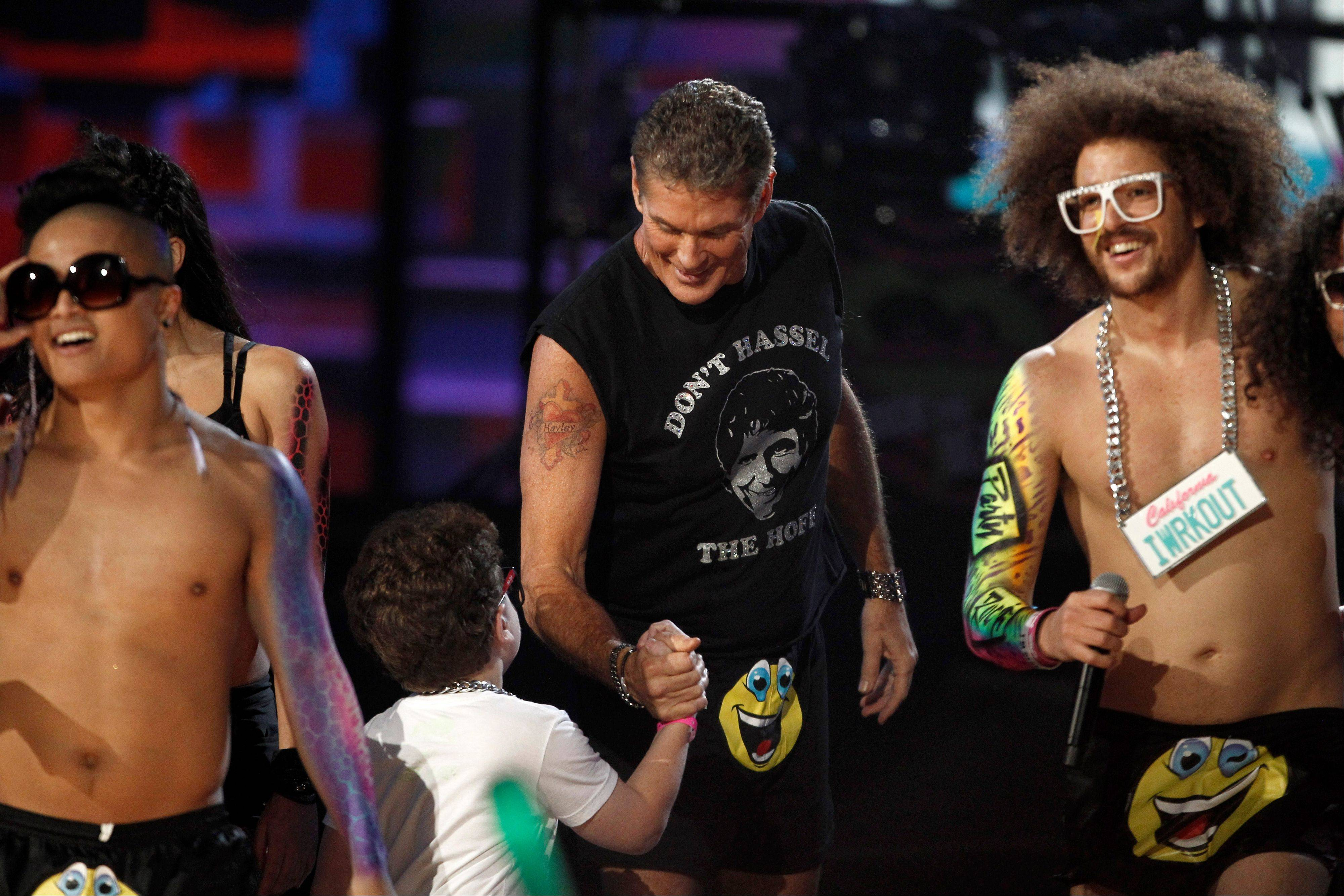 David Hasselhoff and Keenan Cahill are seen onstage while LMFAO perform at the 39th Annual American Music Awards on Sunday, Nov. 20, 2011 in Los Angeles.