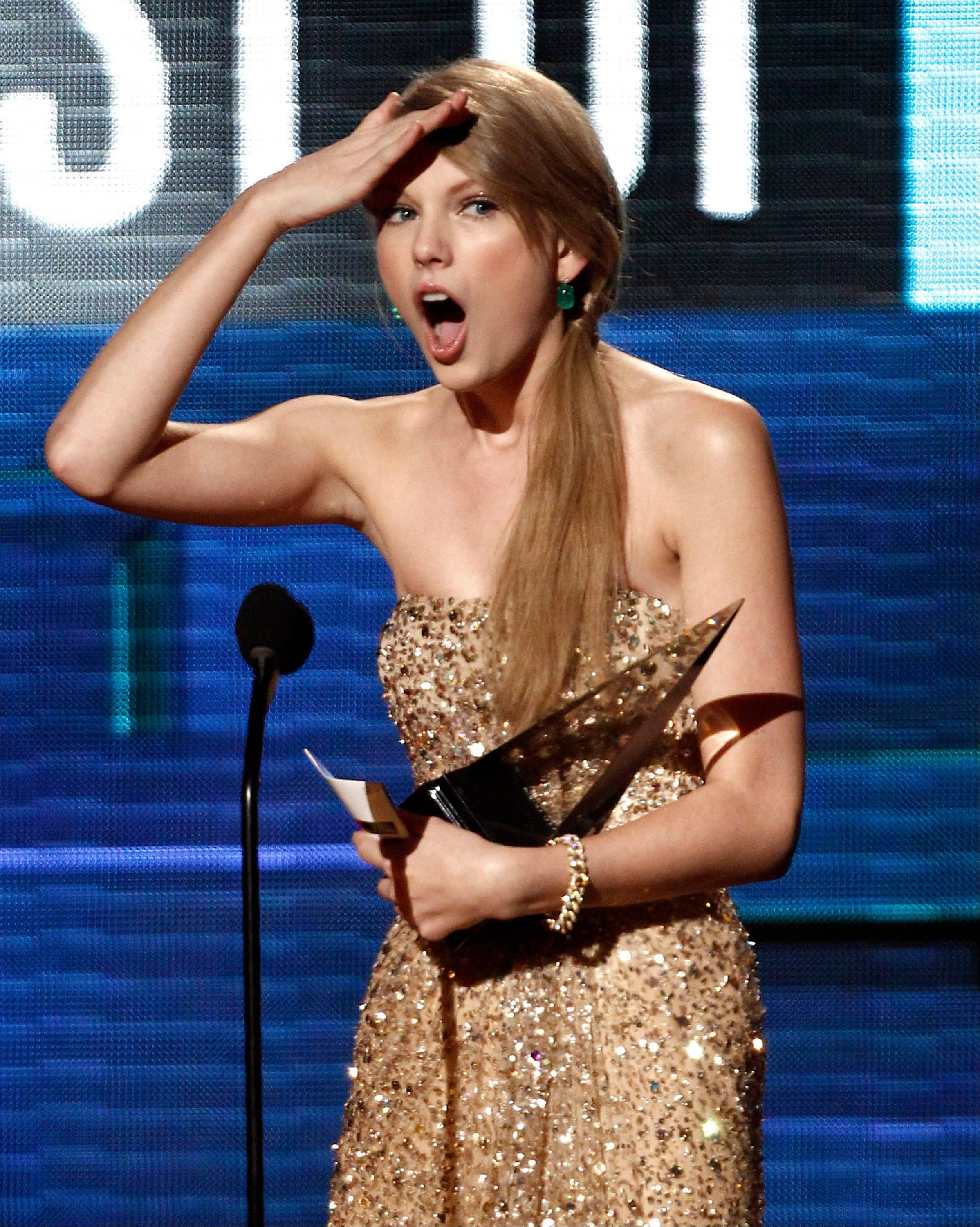 Taylor Swift accepts the award for artist of the year at the 39th Annual American Music Awards on Sunday, Nov. 20, 2011 in Los Angeles.