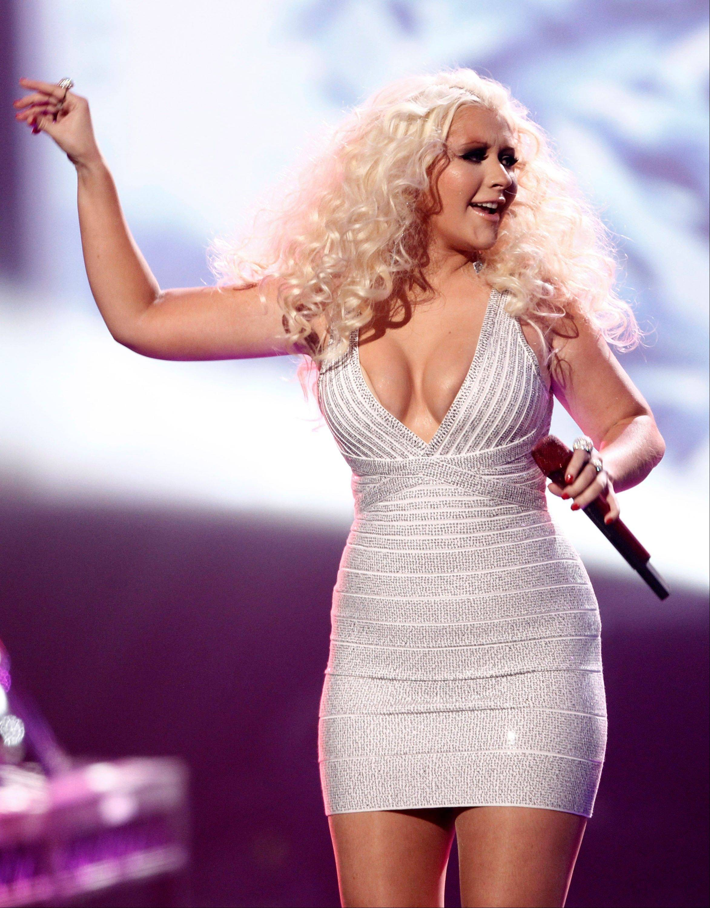 Christina Aguilera performs at the 39th Annual American Music Awards on Sunday, Nov. 20, 2011 in Los Angeles.