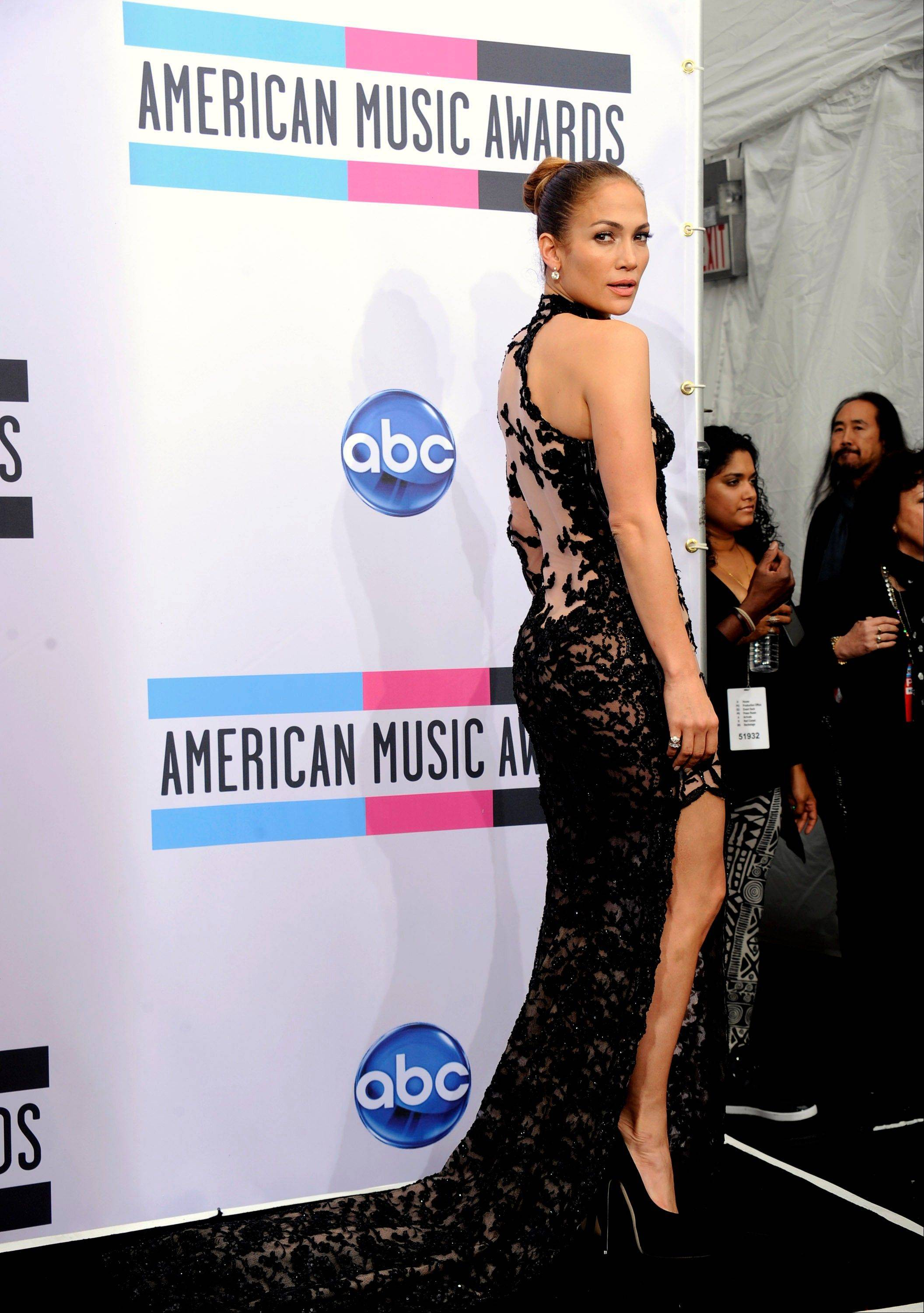 Jennifer Lopez poses backstage at the 39th Annual American Music Awards on Sunday, Nov. 20, 2011 in Los Angeles. (AP Photo/Chris Pizzello)