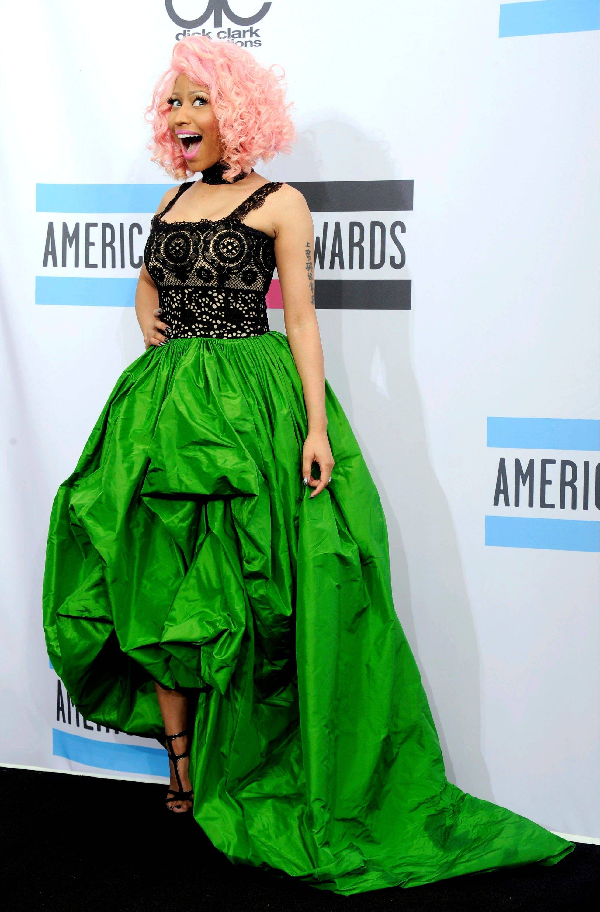 Nicki Minaj poses backstage at the 39th Annual American Music Awards on Sunday, Nov. 20, 2011 in Los Angeles.