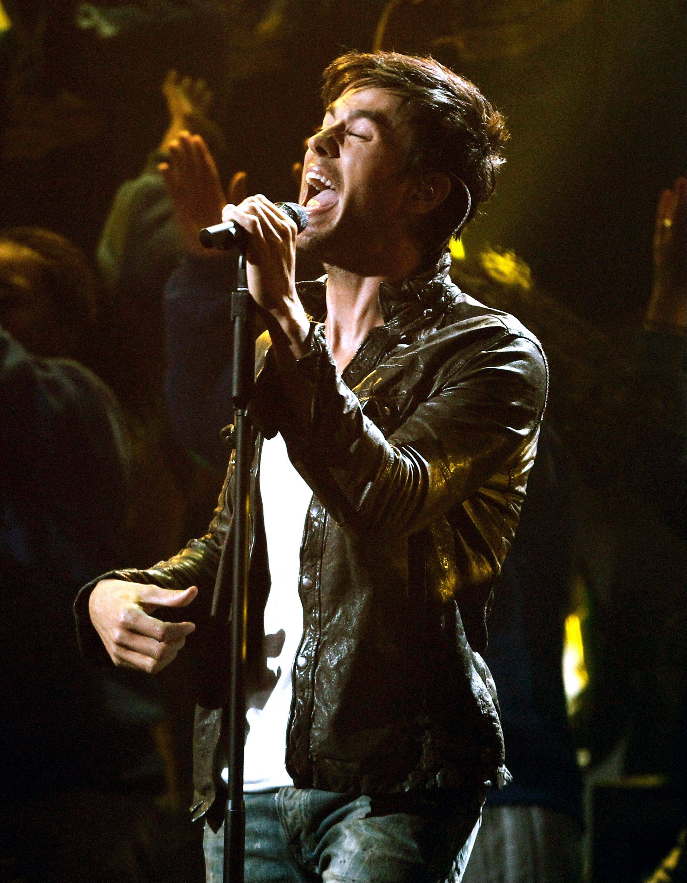 Enrique Iglesias performs at the 39th Annual American Music Awards on Sunday, Nov. 20, 2011, in Los Angeles.