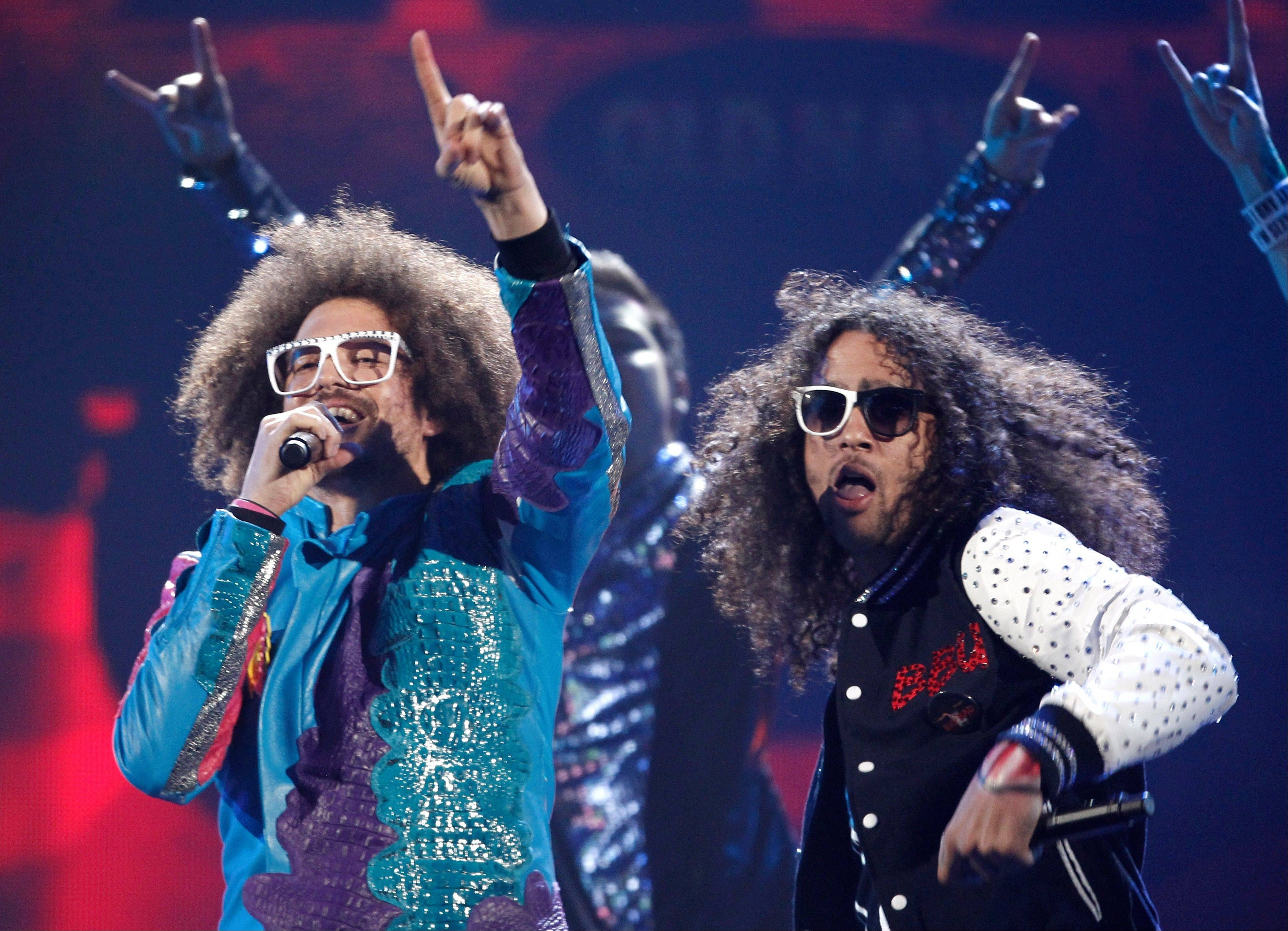 Redfoo, left, and SkyBlu from the music group LMFAO perform at the 39th Annual American Music Awards on Sunday, Nov. 20, 2011 in Los Angeles.