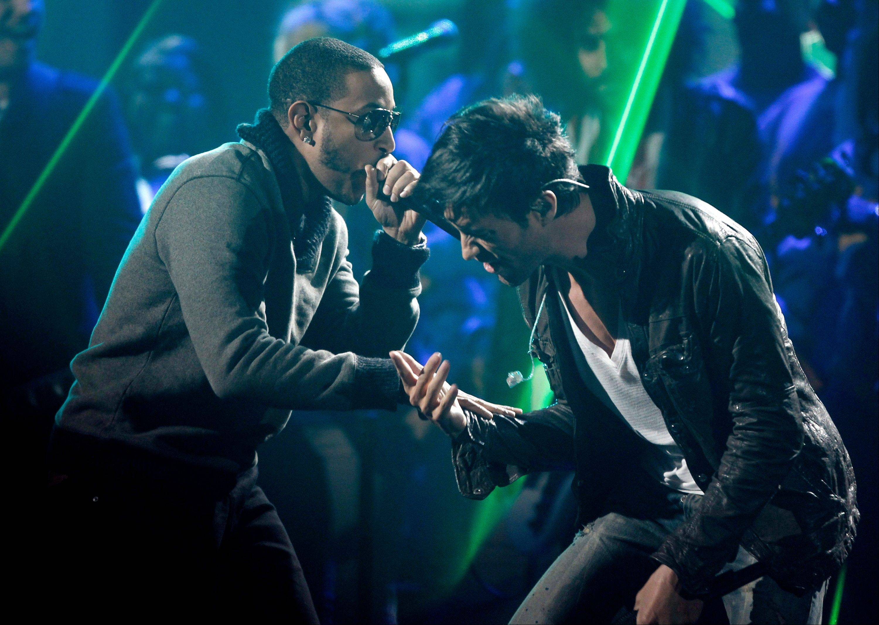 Ludacris, left, and Enrique Iglesias perform onstage at the 39th Annual American Music Awards on Sunday, Nov. 20, 2011 in Los Angeles.