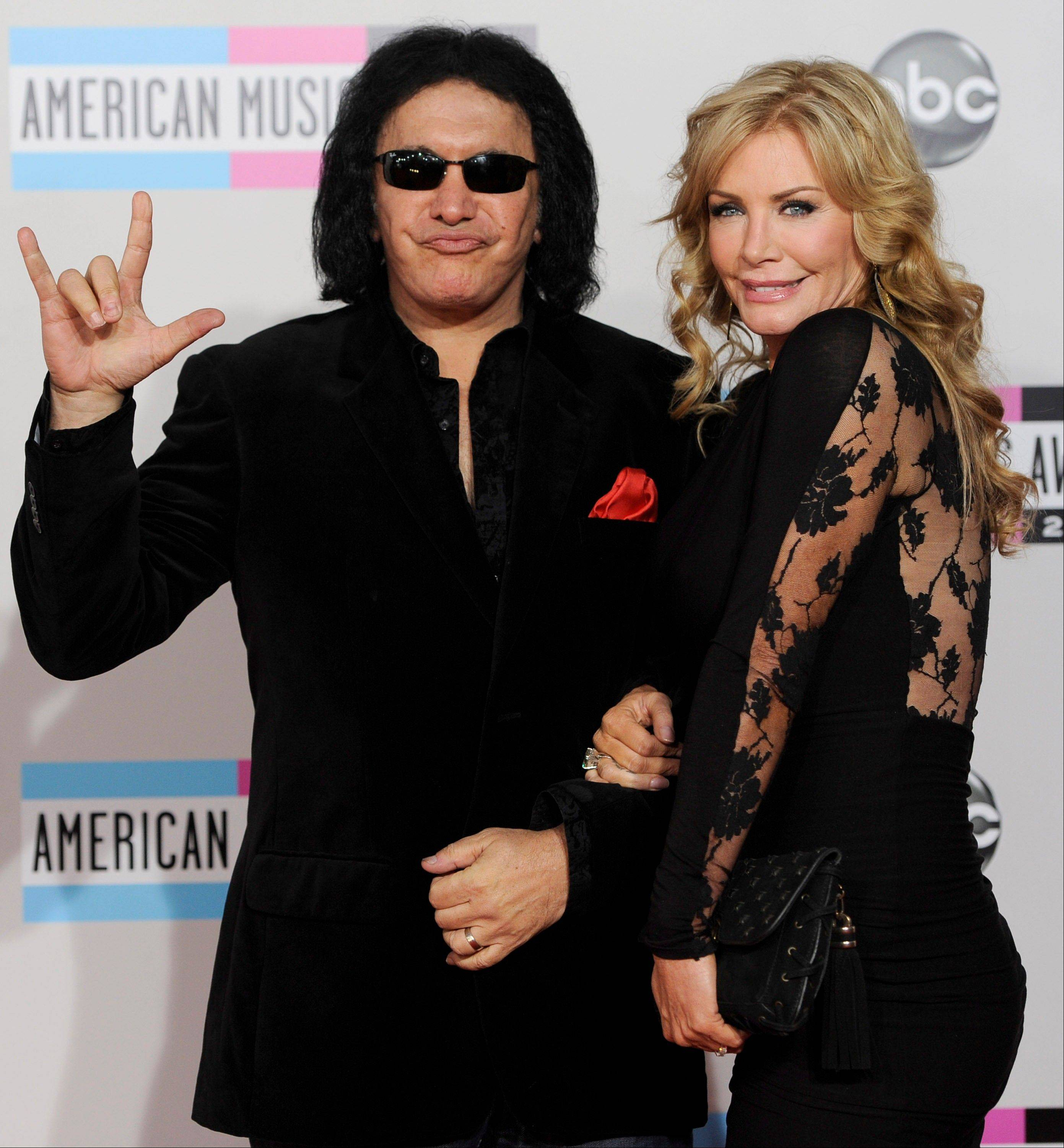Gene Simmons, left, and Shannon Tweed arrive at the 39th Annual American Music Awards on Sunday, Nov. 20, 2011 in Los Angeles.