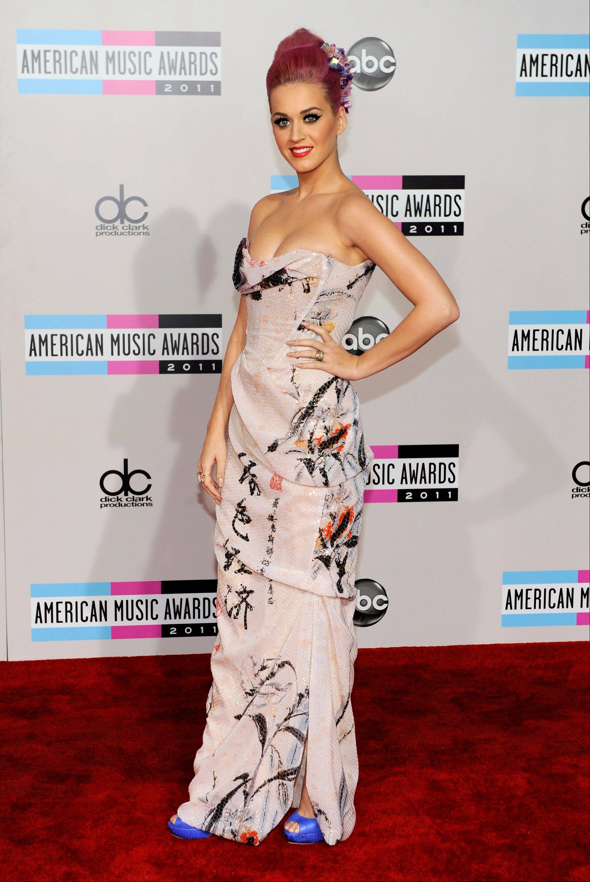 Katy Perry arrives at the 39th Annual American Music Awards on Sunday, Nov. 20, 2011 in Los Angeles.