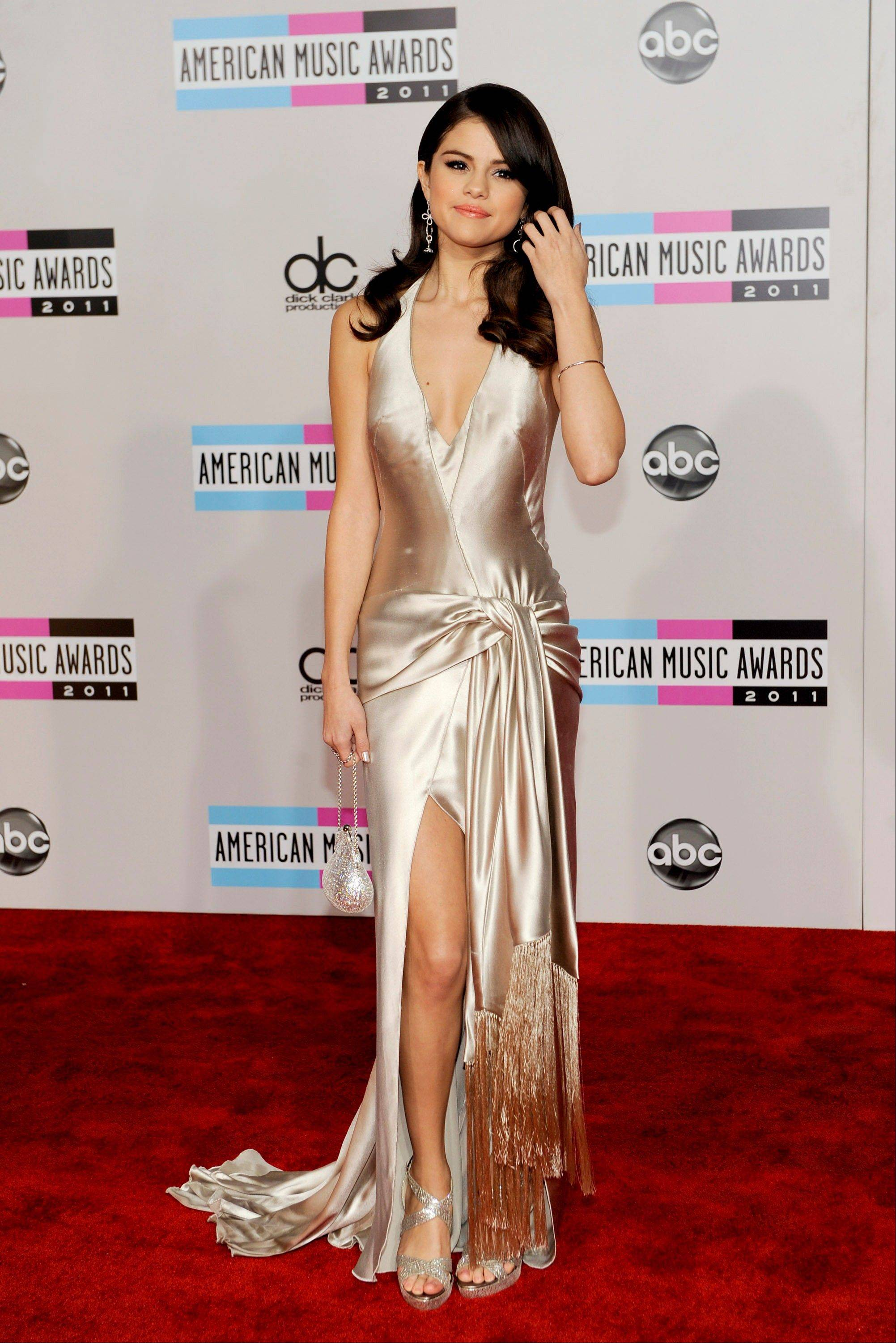 Selena Gomez arrives at the 39th Annual American Music Awards on Sunday, Nov. 20, 2011 in Los Angeles.