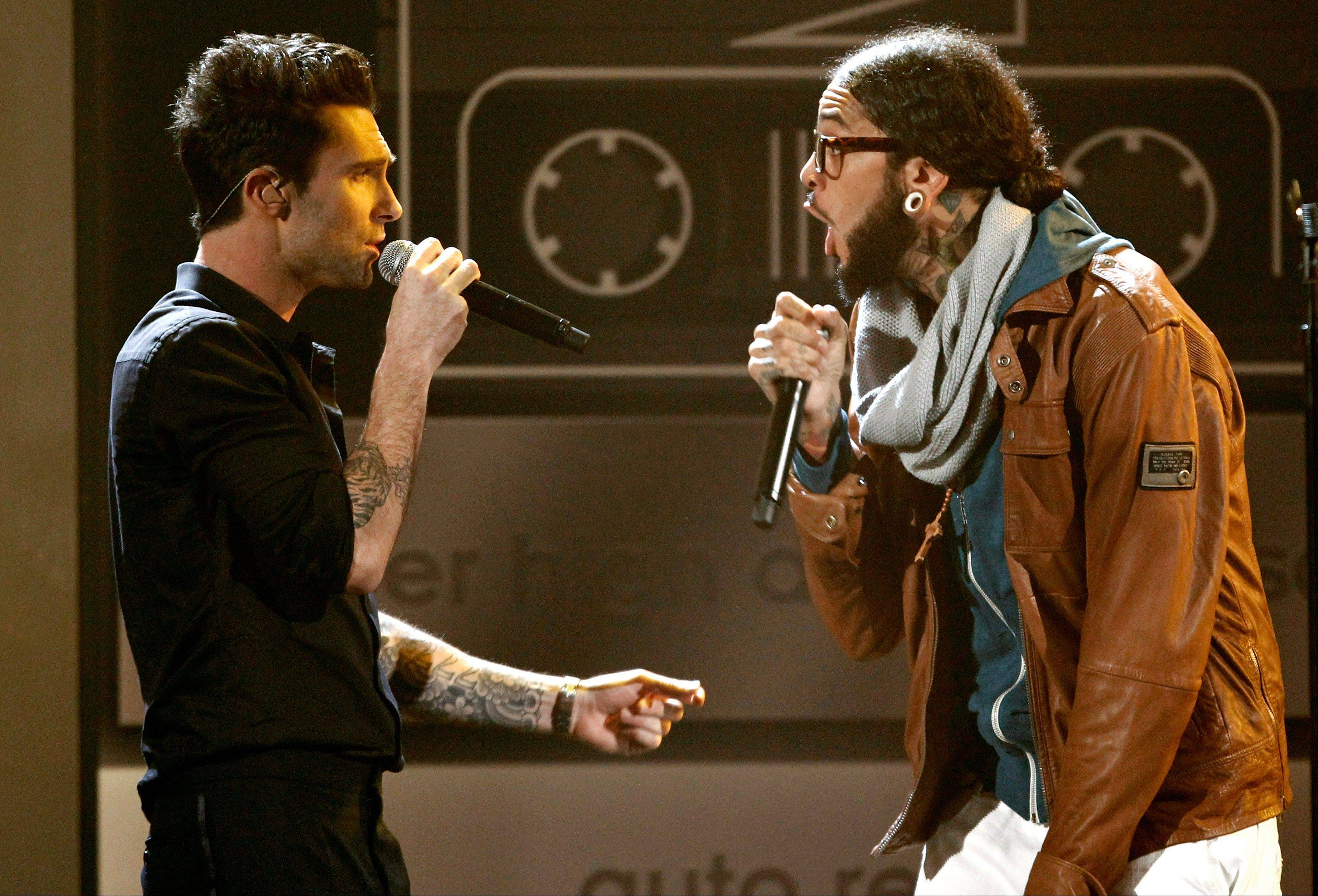 Travis McCoy, right, of Gym Class Heroes and Adam Levine of musical group Maroon 5 perform at the 39th Annual American Music Awards on Sunday, Nov. 20, 2011 in Los Angeles.