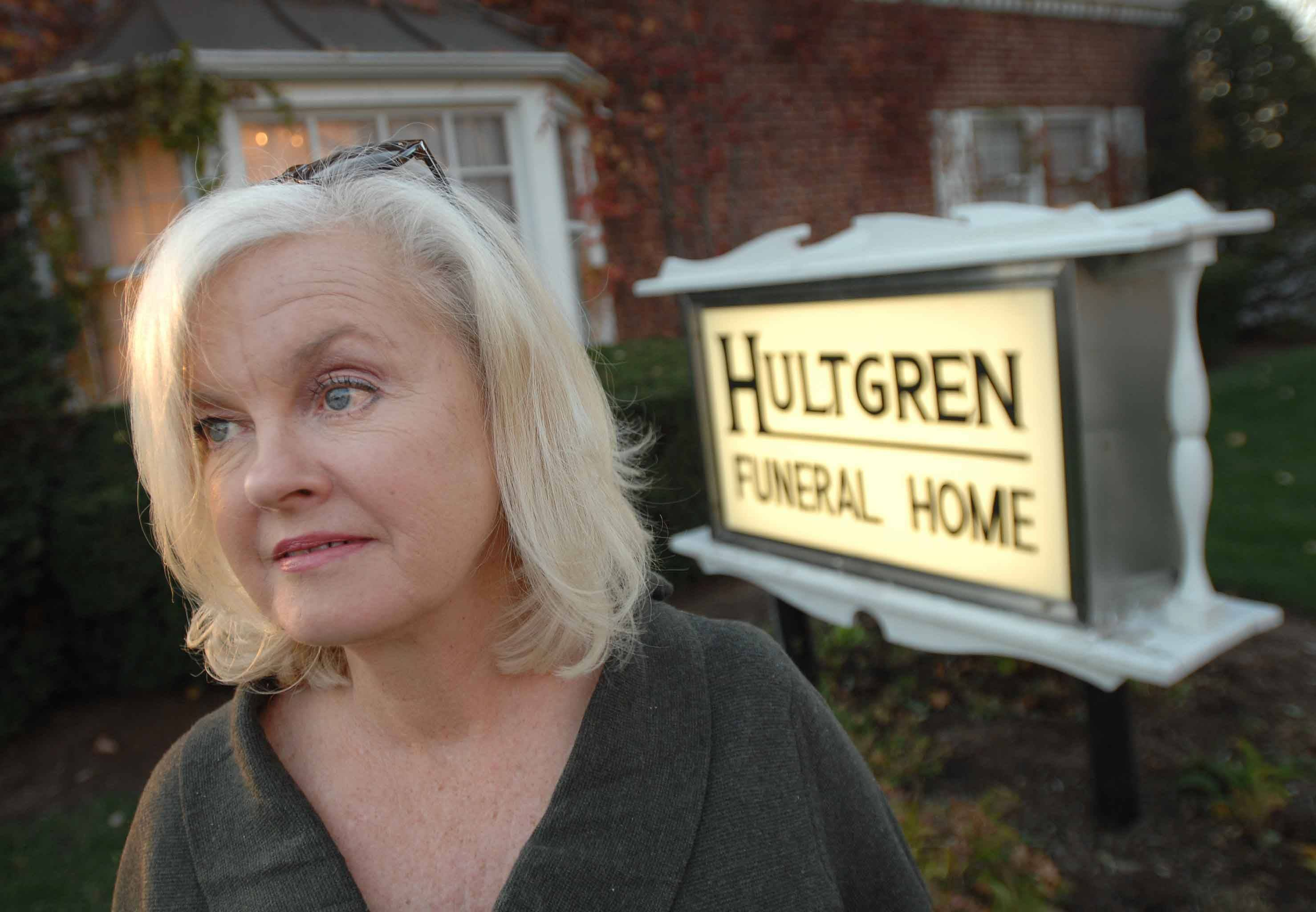 Lea Minalga, who runs the Hearts of Hope organization, stands in front of the Hultgren Funeral Home in Wheaton Tuesday. She has attended more than 100 funerals in the past 10 years for people who have died of drug overdoses.