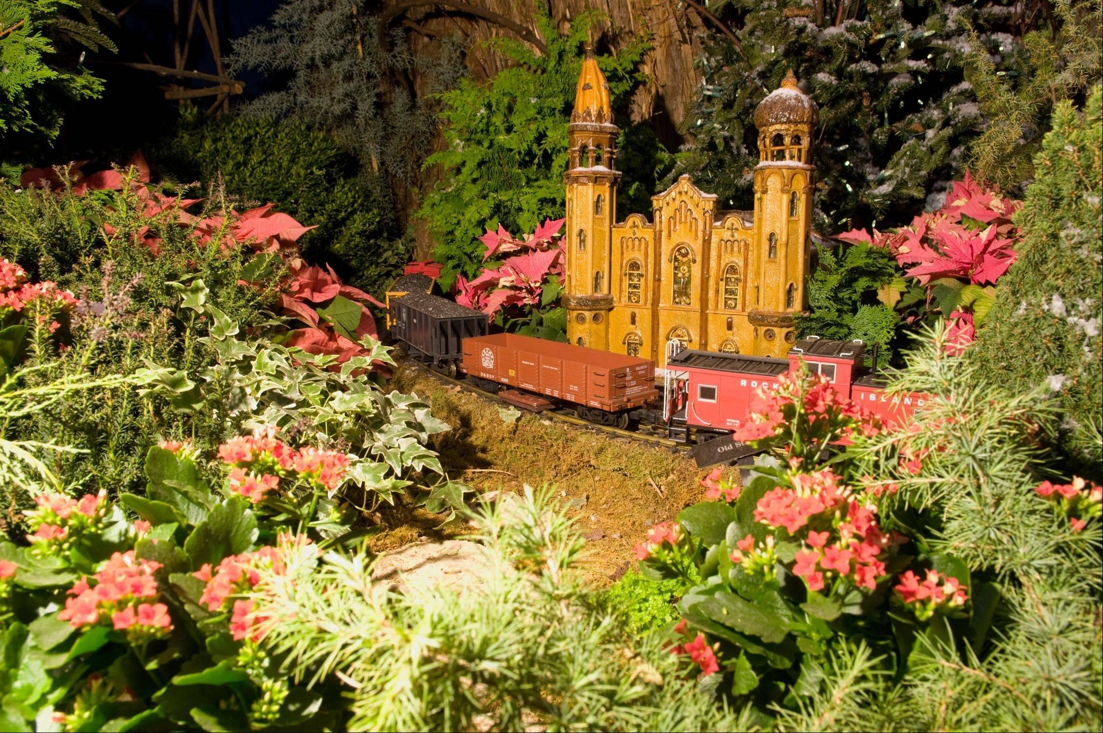A miniature trains whisks by a model of Old St. Patrick's Church at the Chicago Botanic Garden's Wonderland Express, which returns on Friday, Nov. 25.
