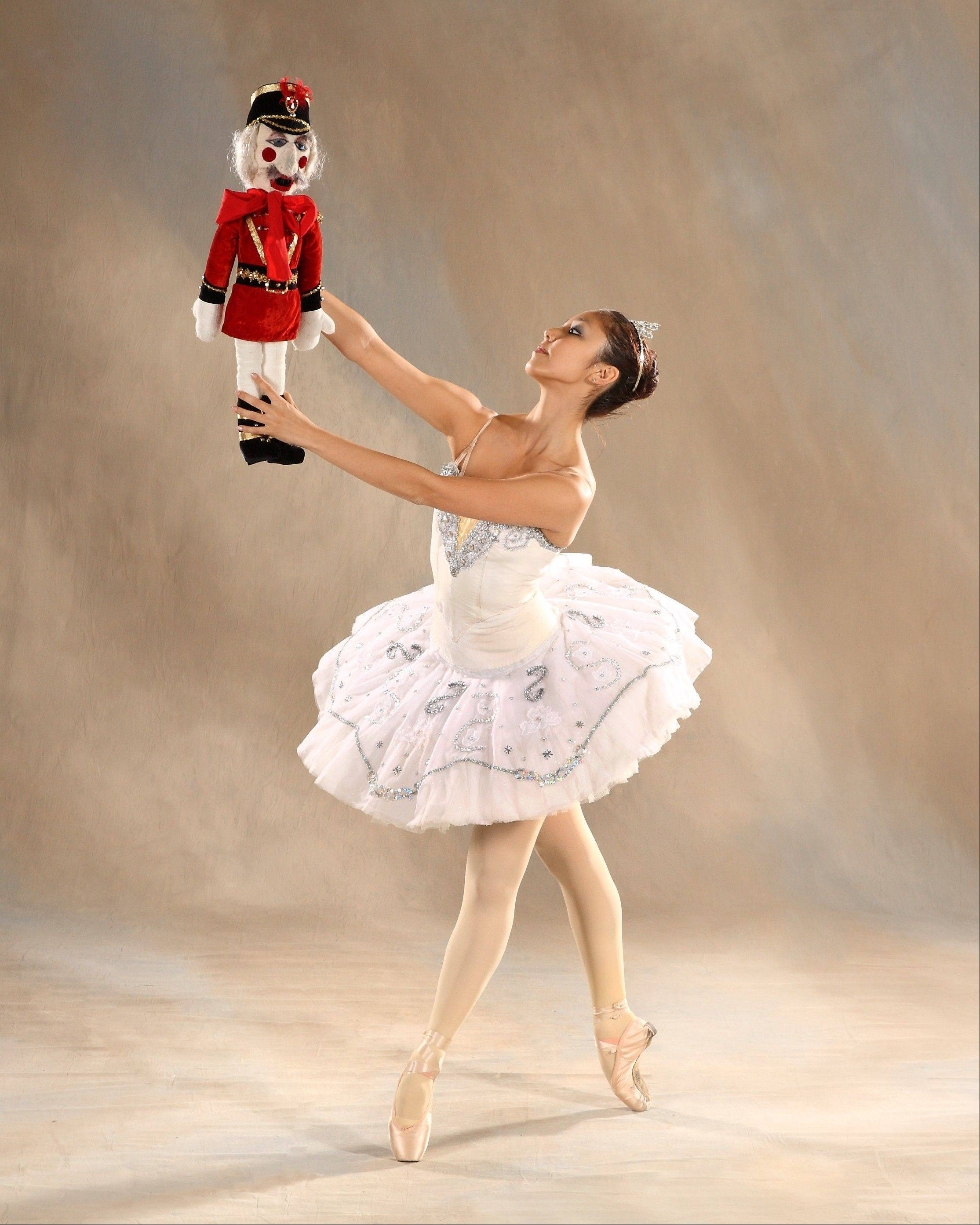 "Clara (Hyesun Park) dances with her toy Nutcracker in Salt Creek Ballet's production of ""The Nutcracker,"" starting first in Hinsdale before touring to Aurora, University Park and Skokie."