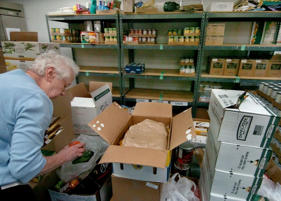 Volunteer Betty Hickman sorts through produce at the Des Plaines food pantry run by Catholic Charities.