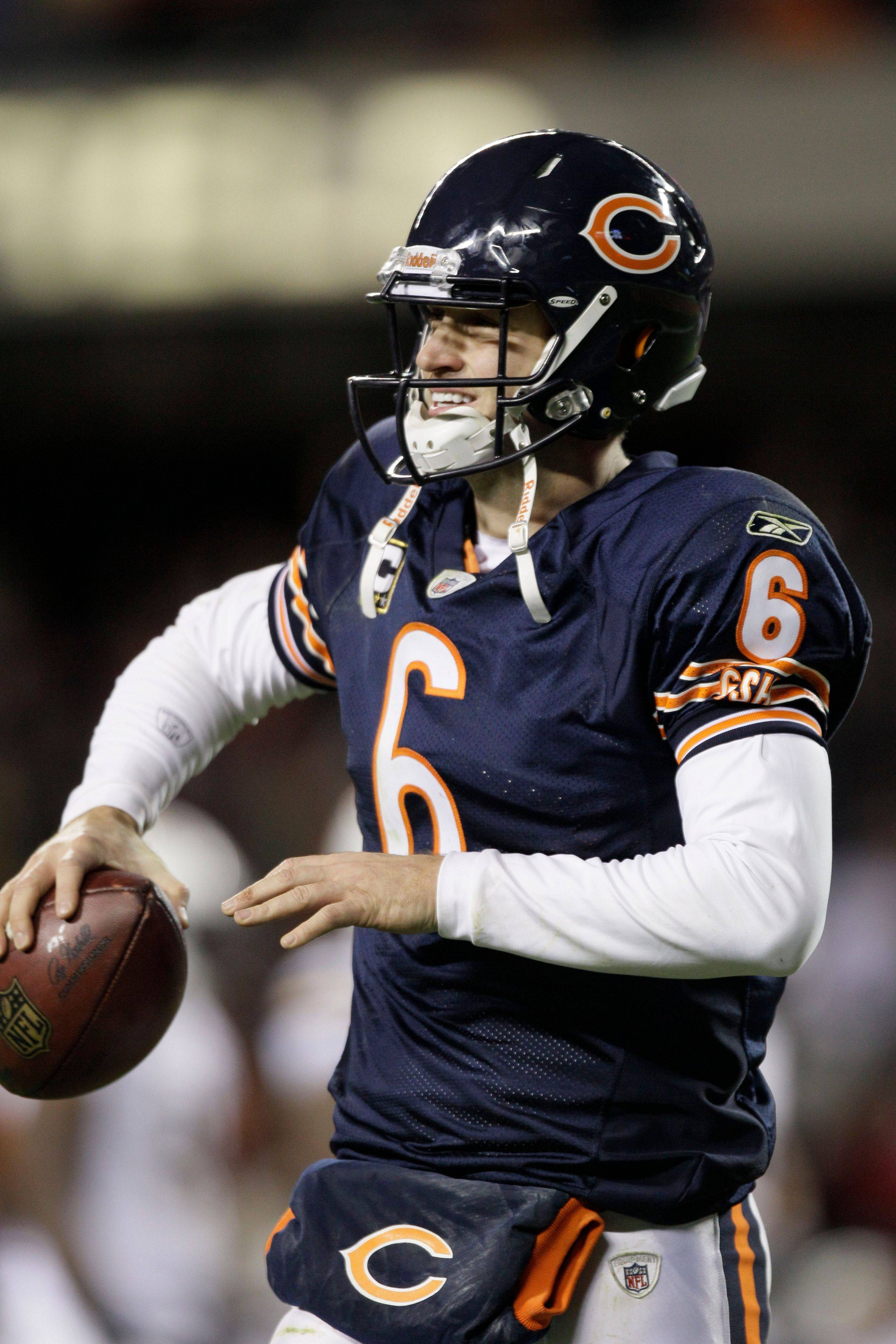 Bears quarterback Jay Cutler warms up on the sideline before going back in the game after injuring his right thumb in the fourth quarter Sunday.