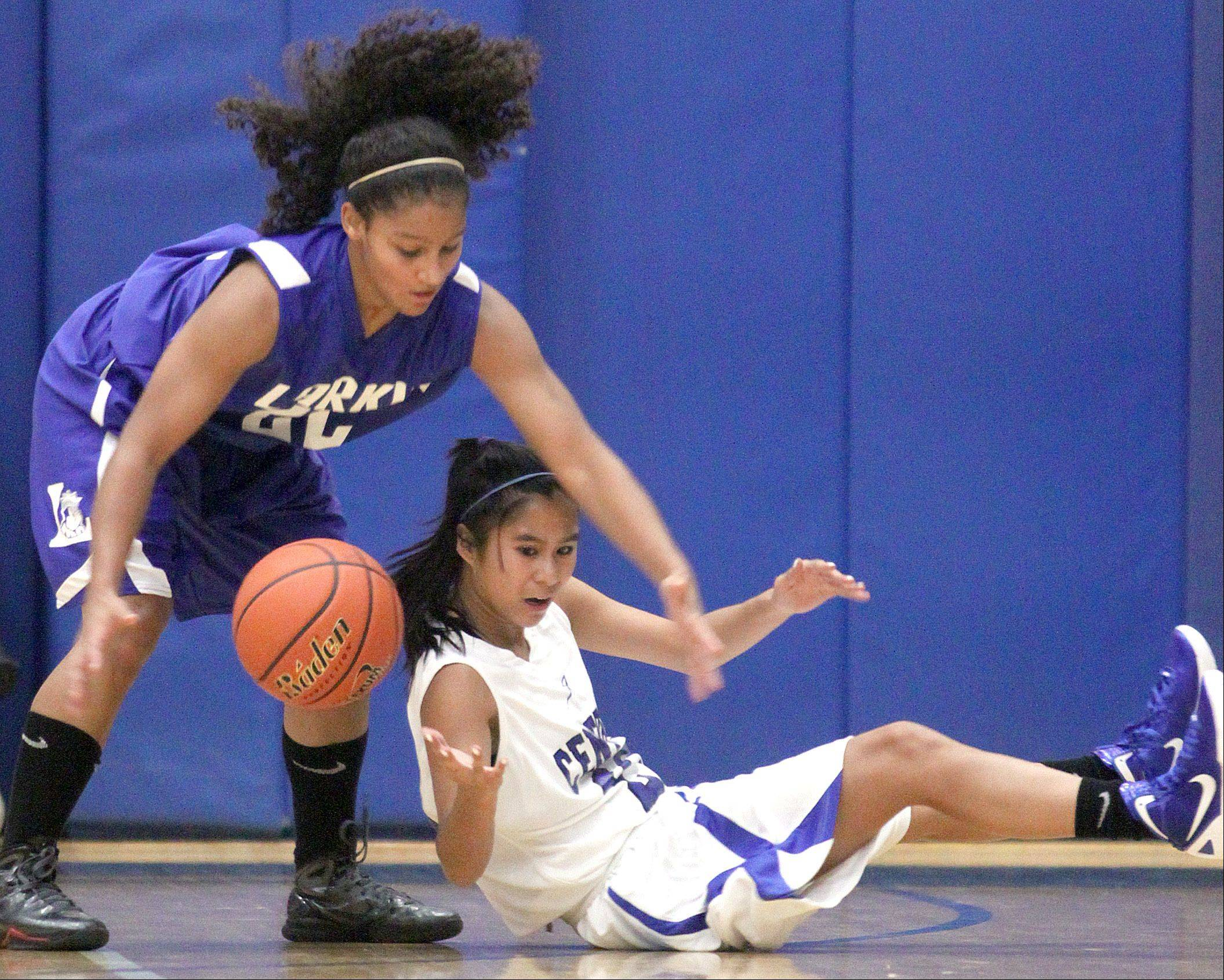 Burlington Central's Camille Dela Cruz, right, and Larkin's Victoria Patterson scramble for a loose ball during a Central High School Thanksgiving Tournament game in Burlington Friday.