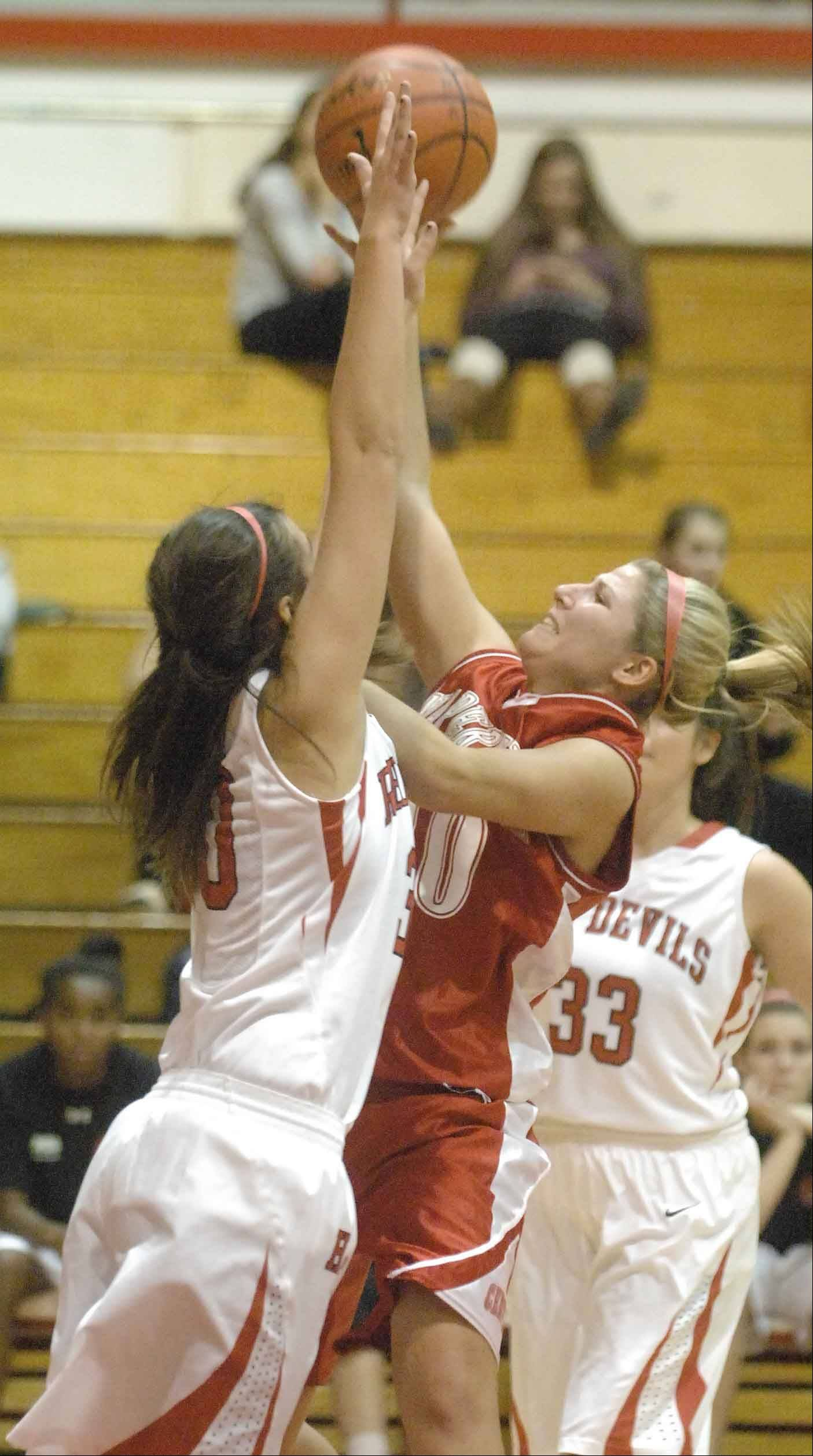 Hinsdale Central's Jenna Broz, left, blocks Naperville Central's Jill D'Amico during Tuesday's game action in Hinsdale.