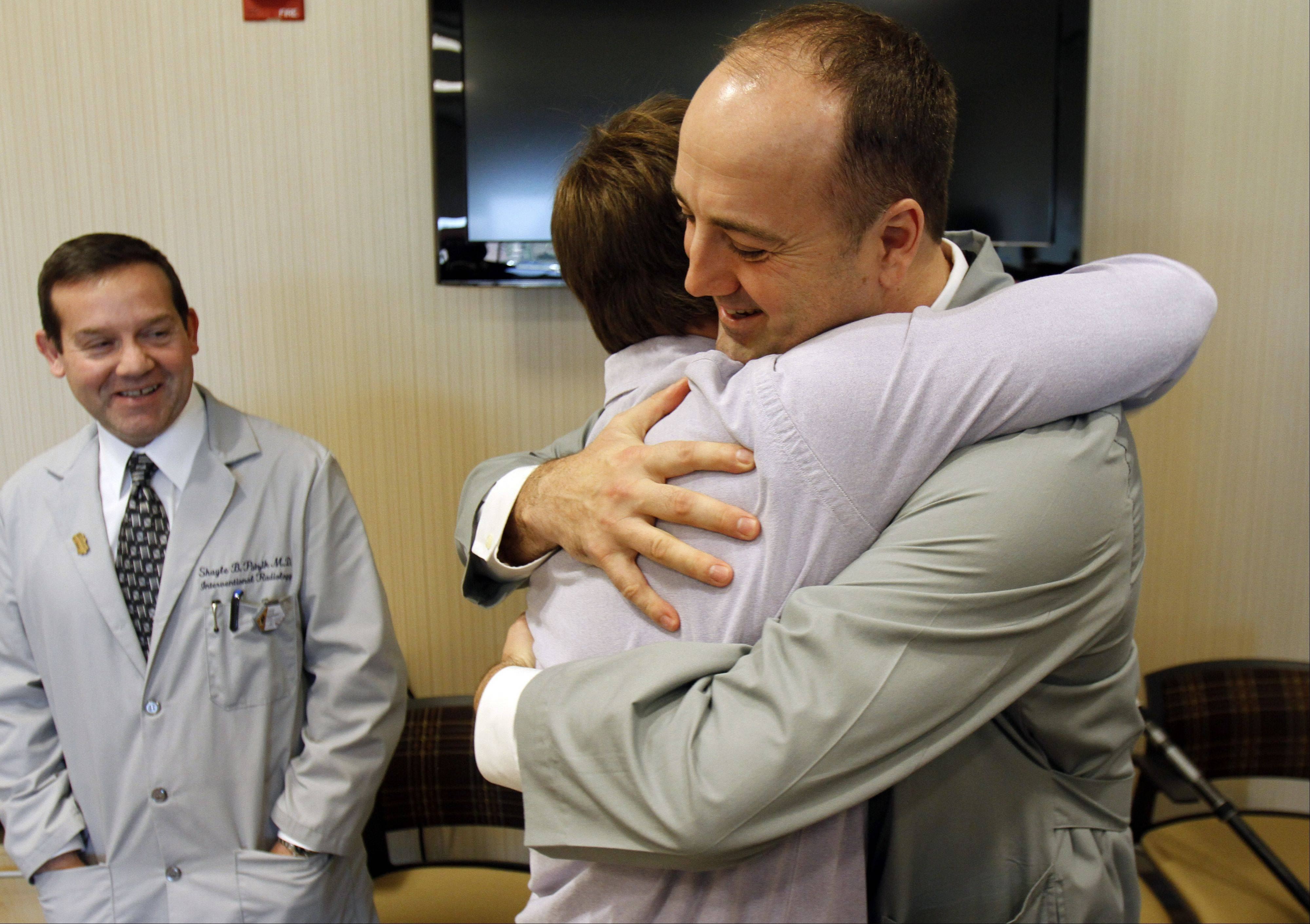 Forrest Ericksen, 18 of Lake Villa, hugs trauma surgeon Dr. William Watson at Advocate Condell Medical Center in Libertyville Wednesday. Watson and other surgeons at Condell's level 1 trauma unit saved Ericksen's life after a snowmobile accident almost two years ago.