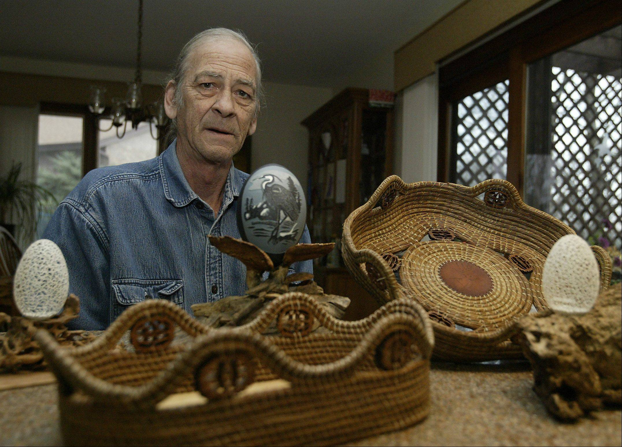 John Warnock of Gilberts has had a lifetime of art projects. From pastels and chalk drawings to woodcarving and lathe work he has settled on pine needle baskets and carving eggshells as his latest craft. Warnock will display his work at the Christmas on the Fox Art and Craft Show this weekend.